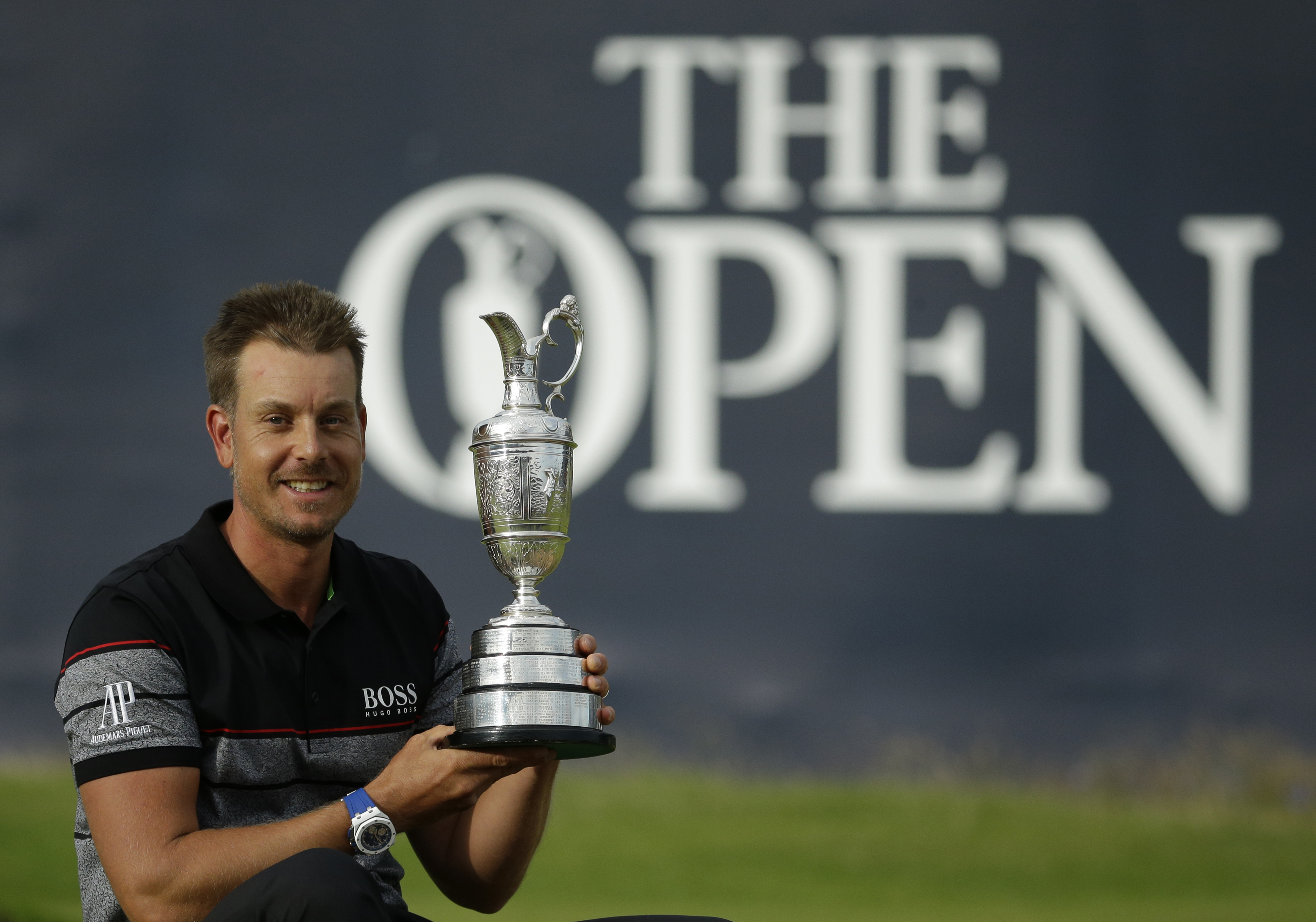 Henrik Stenson of Sweden poses with the trophy after winning the British Open Golf Championships at the Royal Troon Golf Club in Troon, Scotland, Sunday, July 17, 2016. (AP Photo/Matt Dunham)