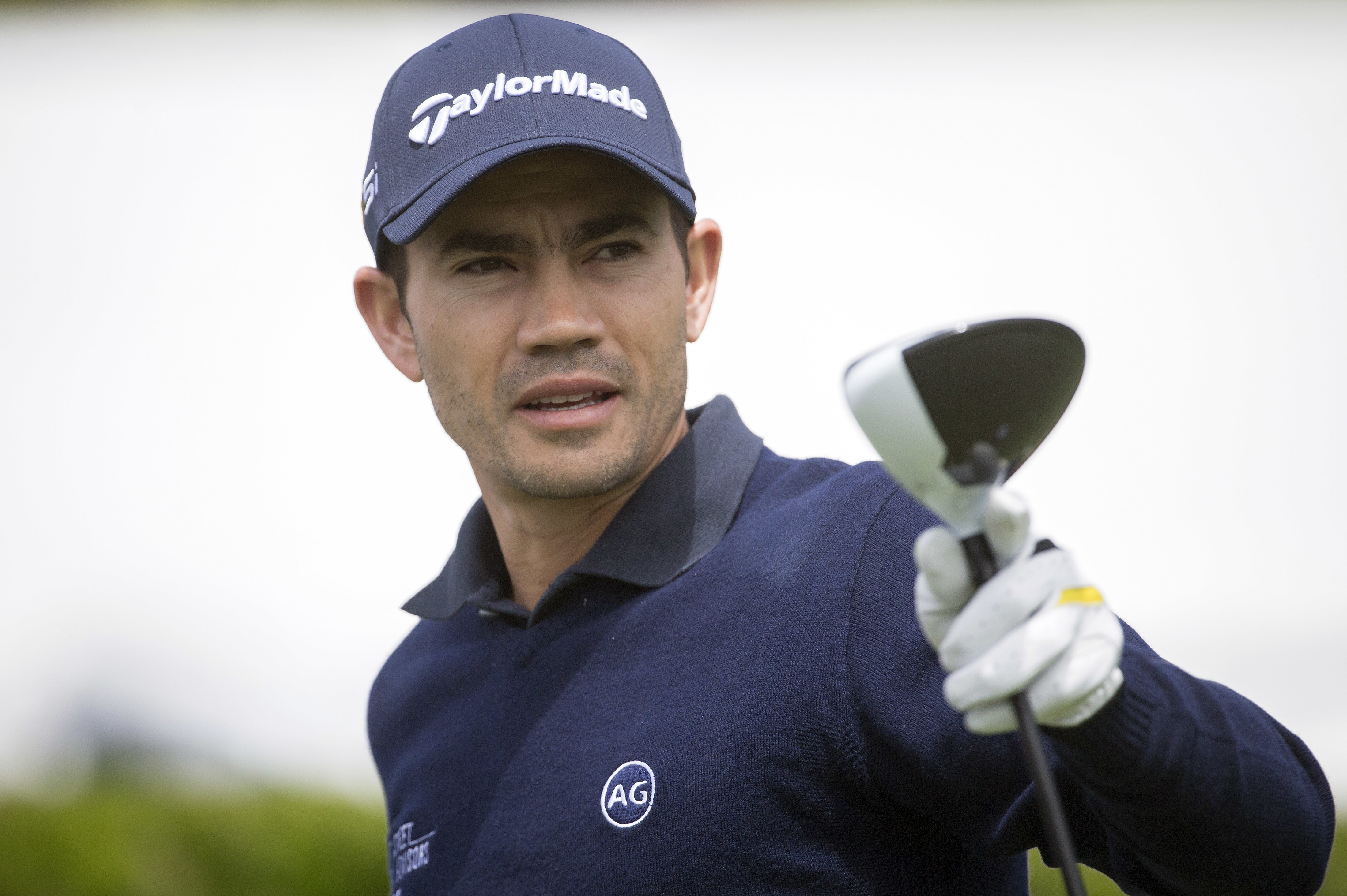 FILE - In this April 14, 2016, file photo, Camilo Villegas, of Colombia, prepares to tee off on the first hole during the first round of the RBC Heritage golf tournament in Hilton Head Island, S.C.  Villegas has pulled out of the Olympics because he is tr
