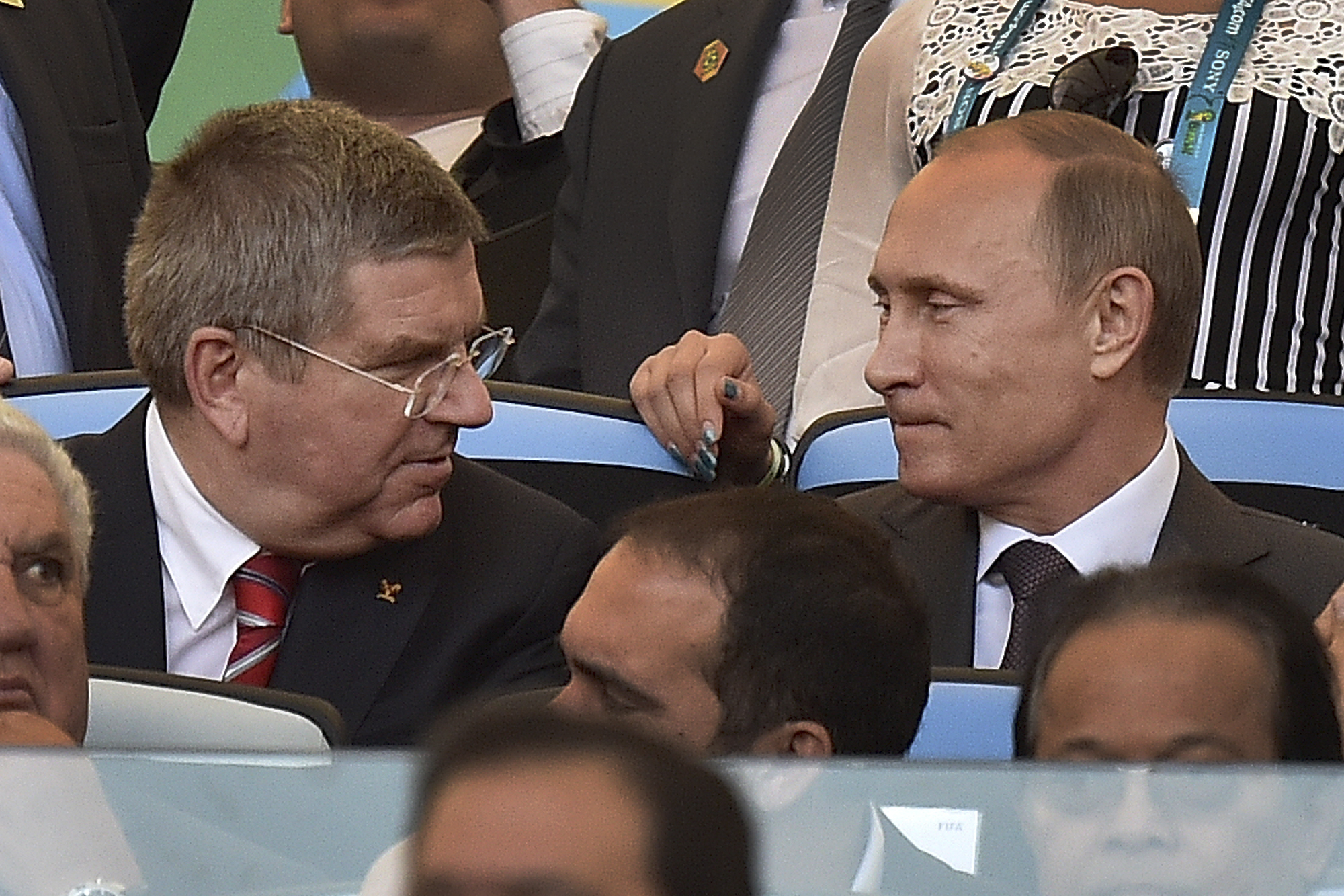 FILE - In this July 13, 2014 file photo International Olympic Committee President Thomas Bach, left, talks with Russian President Vladimir Putin before the World Cup final soccer match between Germany and Argentina at the Maracana Stadium in Rio de Janeir