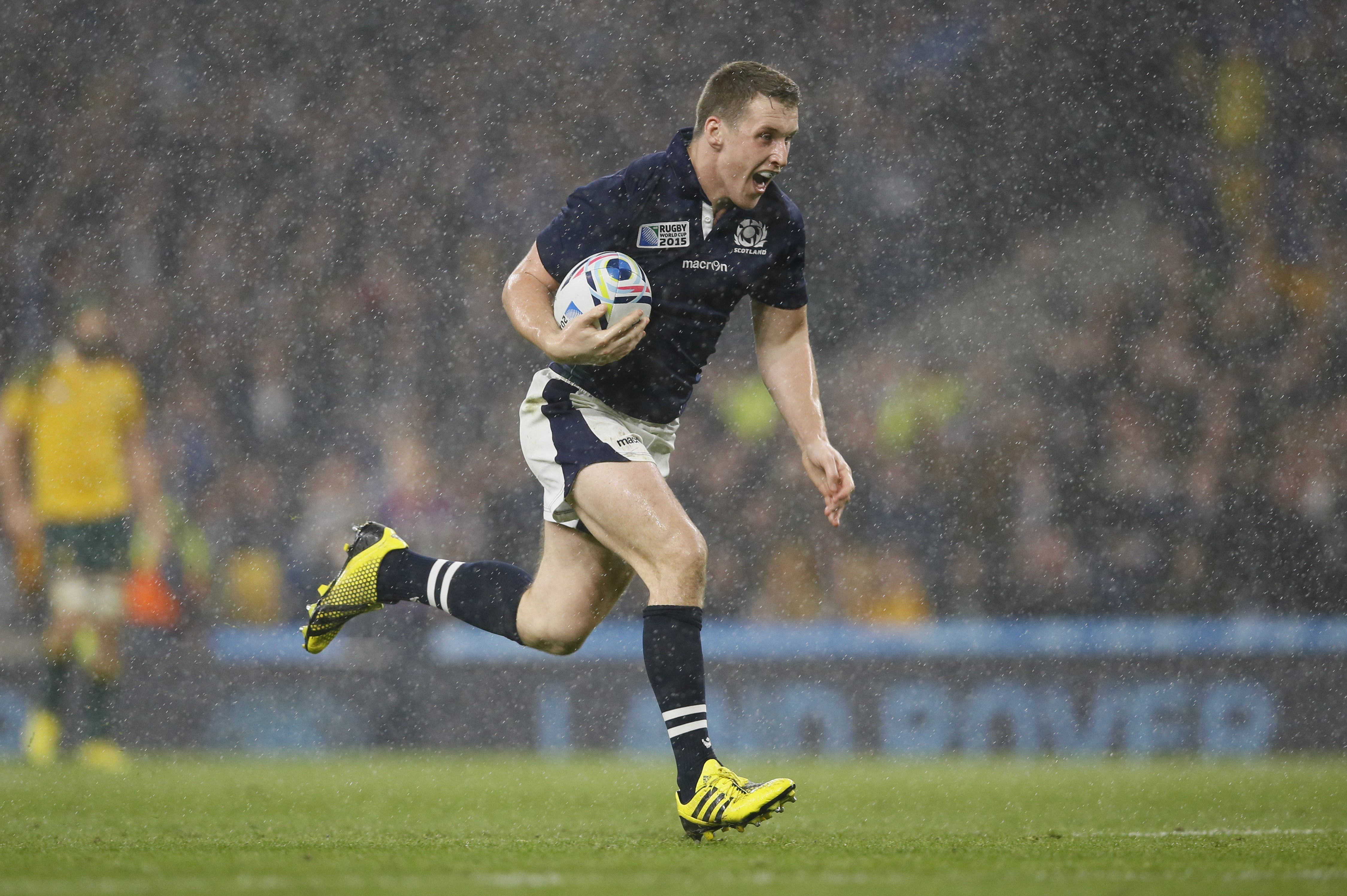 Scotland's Mark Bennett runs in to score a try during the Rugby World Cup quarterfinal match between Australia and Scotland at Twickenham Stadium, London, Sunday, Oct. 18, 2015. (AP Photo/Kirsty Wigglesworth)