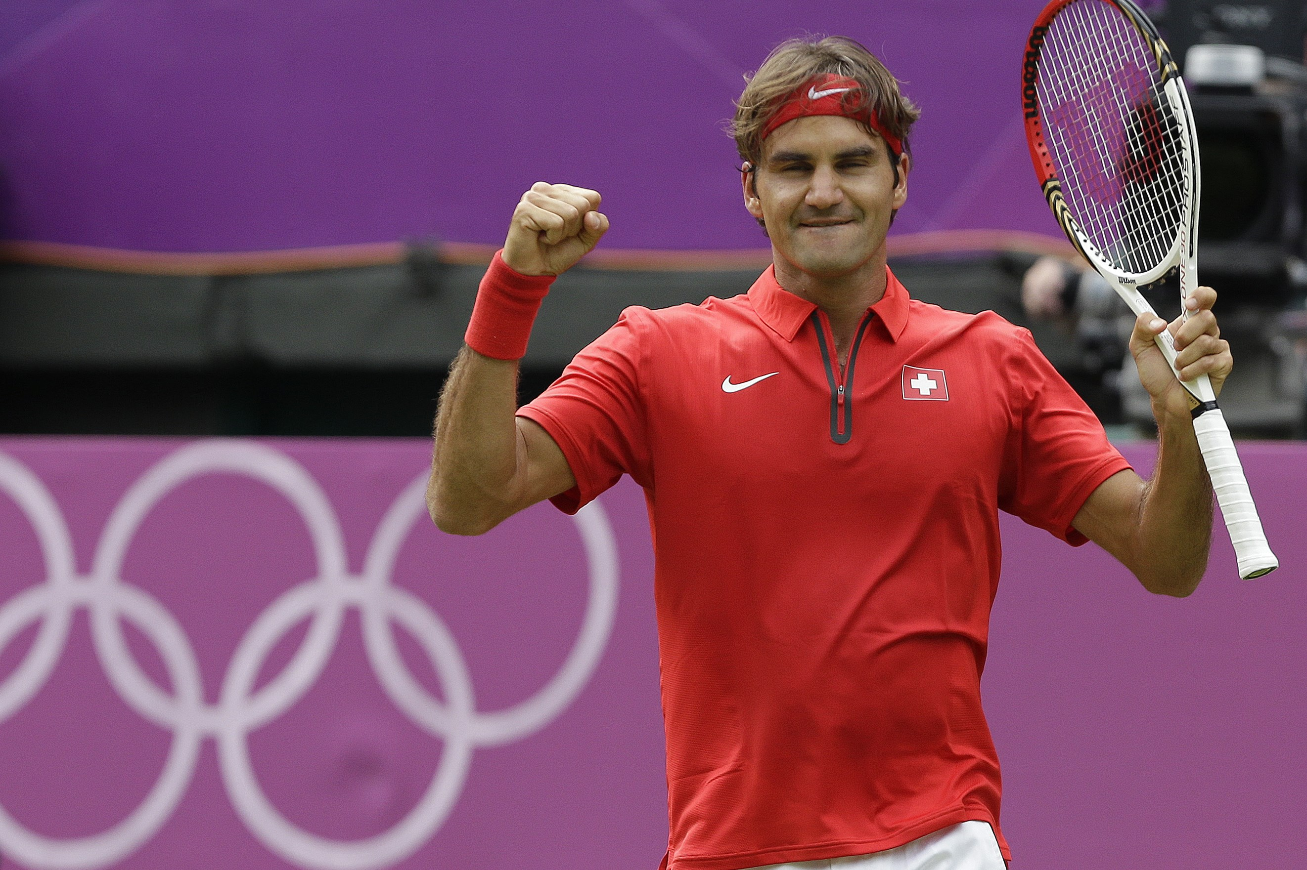 "FILE - In this July 28, 2012, file photo, Roger Federer of Switzerland celebrates his 6-3, 5-7, 6-3 victory over Alejandro Falla of Colombia at the All England Lawn Tennis Club in Wimbledon, London at the 2012 Summer Olympics. The ""Big 4"" of men's tennis"
