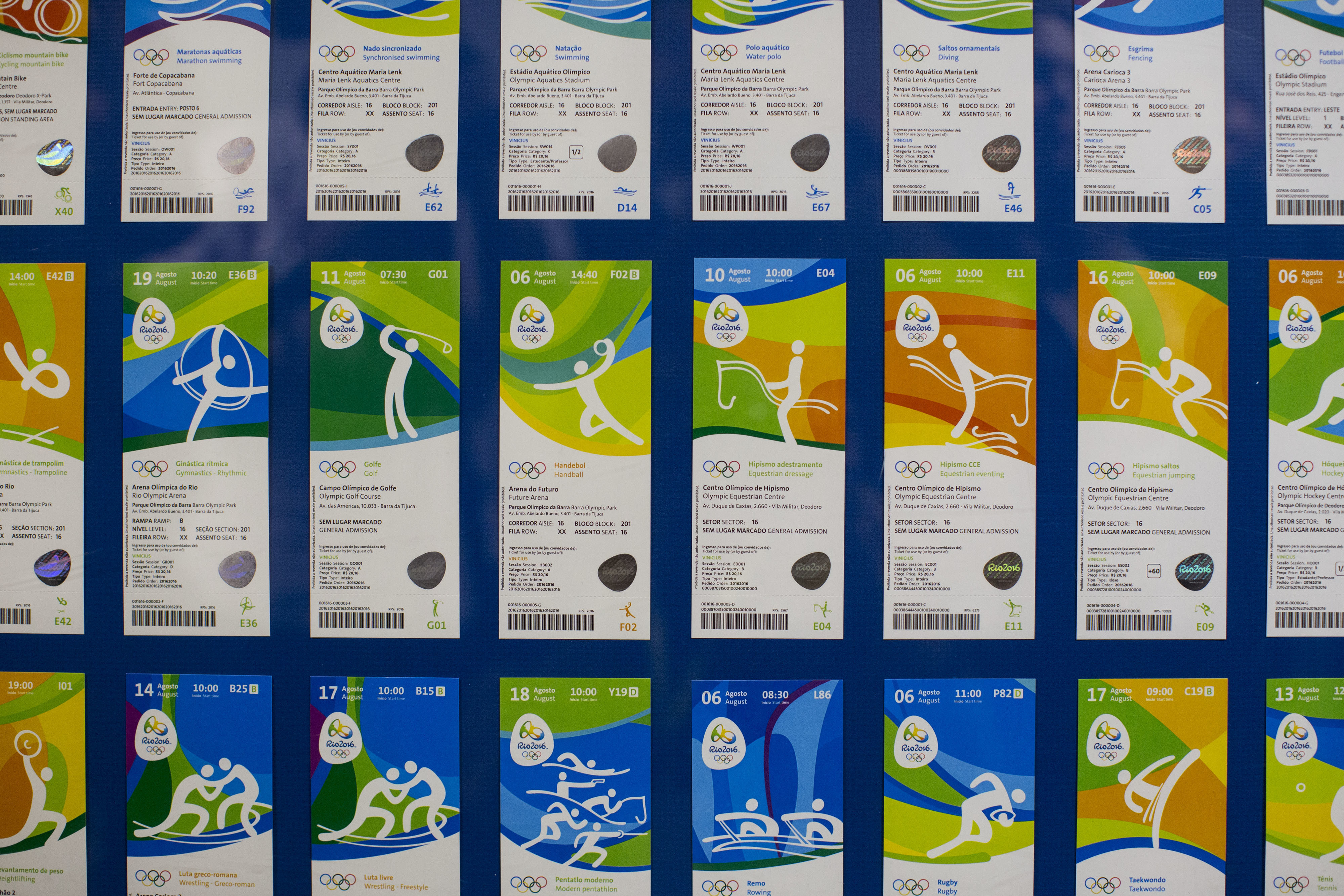 In this May 20, 2016 file photo, Olympic tickets are displayed during an event at the Rio 2016 headquarters in Rio de Janeiro, Brazil. Non-Brazilians who bought Olympic tickets early may be regretting it, having paid higher prices and add-on fees. In a la