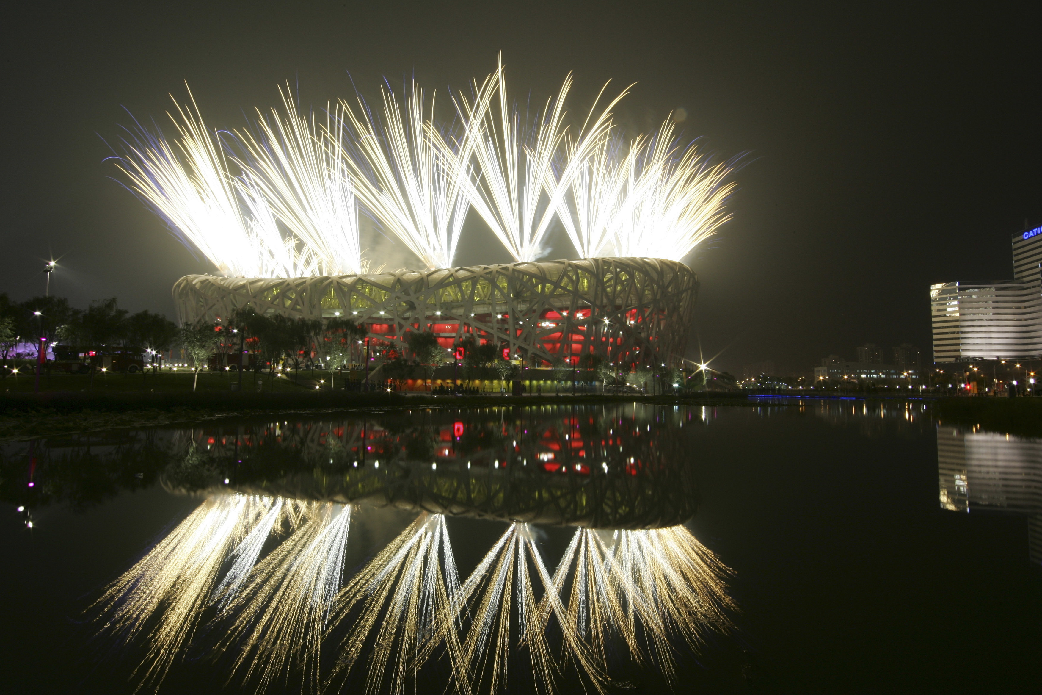 FILE - In this Aug. 8, 2008 file photo fireworks explode during the opening ceremony in the National Stadium at the Beijing 2008 Olympics in Beijing. The IOC said Friday July 22, 2016, that 45 more athletes  including 23 medalists  have been caught for do