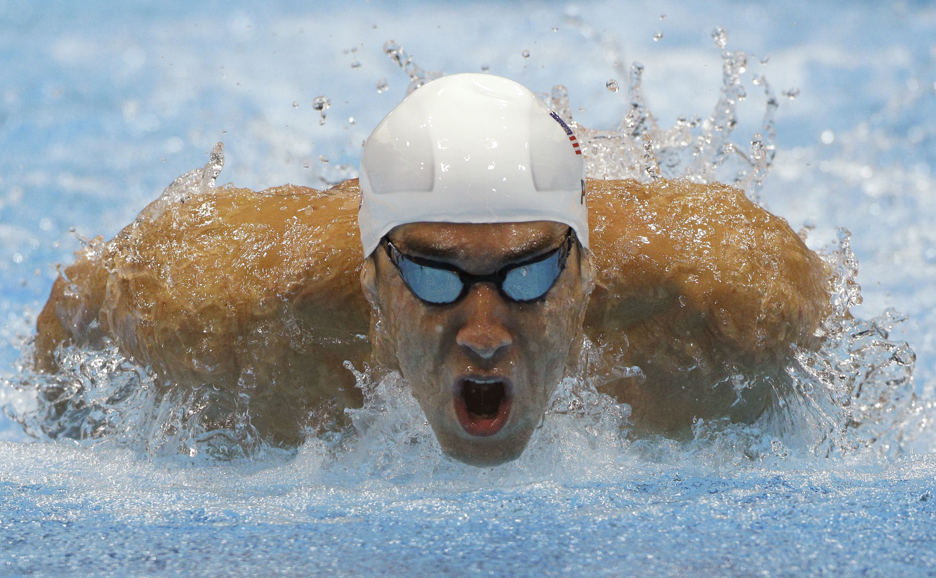 FILE - In this July 28, 2012, file photo, Michael Phelps competes in a heat of the men's 400-meter individual medley at the 2012 Summer Olympics in London. After retiring and then un-retiring, Phelps will be in Rio as the first U.S. male swimmer to compet