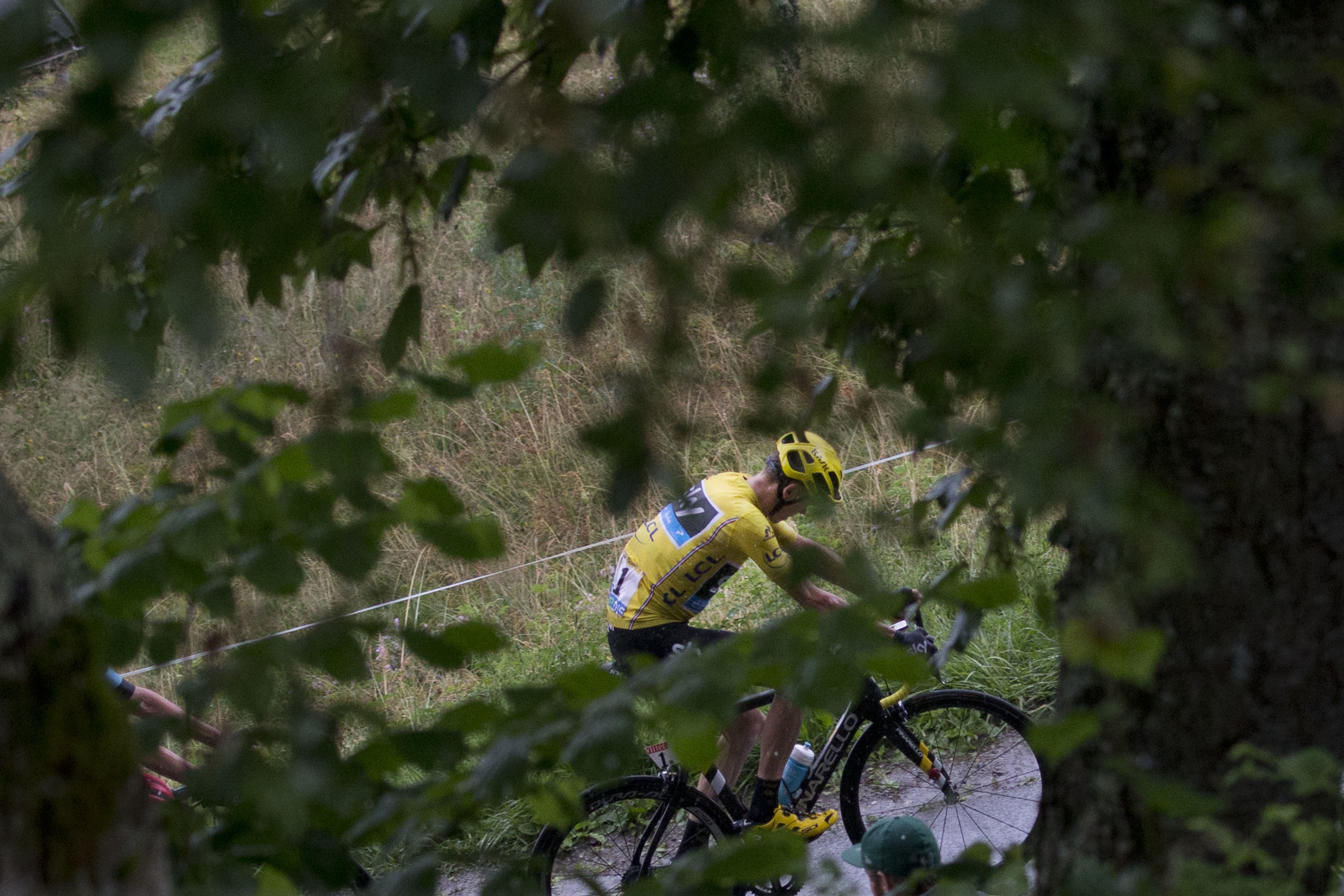 Britain's Chris Froome, wearing the overall leader's yellow jersey, climbs during the twentieth stage of the Tour de France cycling race over 146.5 kilometers (90.7 miles) with start in Megeve and finish in Morzine-Avoriaz, France, Saturday, July 23, 2016