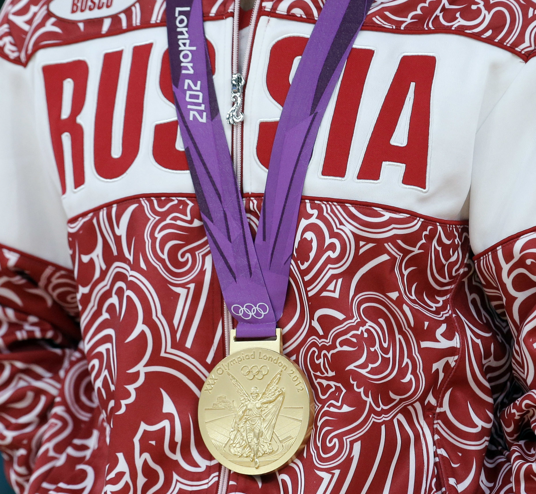 FILE - In this Aug. 10, 2012 file photo a gold medalist from Russia participates in a medals ceremony at the 2012 Summer Olympics in London. The IOC's ruling 15-member executive board will meet Sunday, July 24, 2016 via teleconference to weigh the unprece