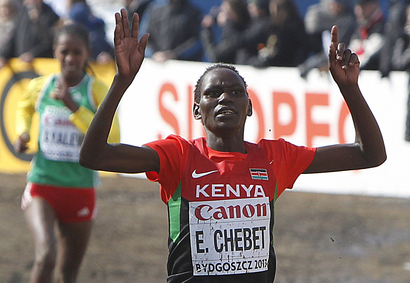 FILE - In this March 24 , 2013 file photo, Kenya's Emily Chebet crosses the finish line of the women's race at the Cross Country World Championships in Bydgoszcz, Poland. Never before have Kenyas fabulously successful runners gone to the Olympics in such