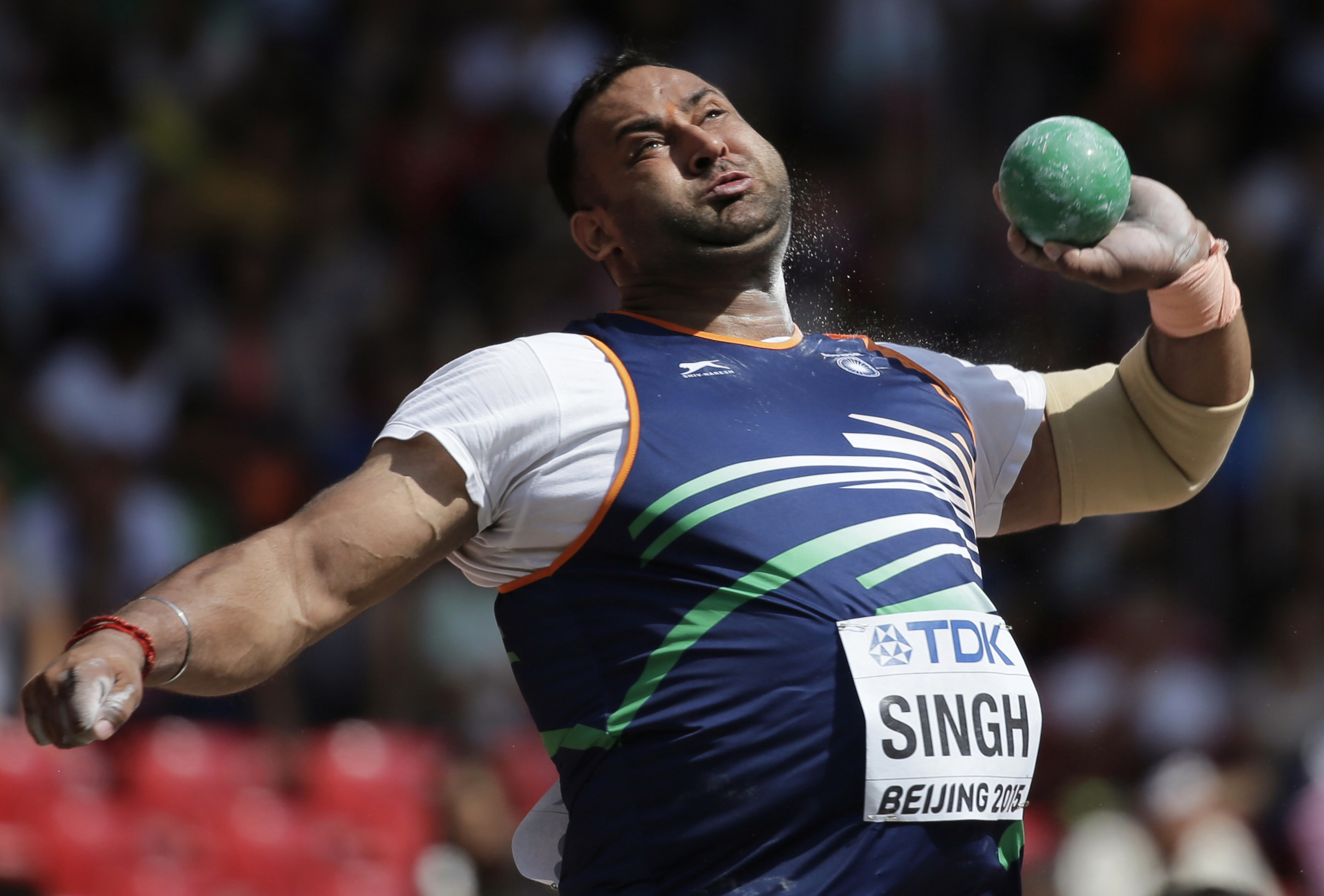 FILE- In this Aug. 23, 2015, file photo, India's Inderjeet Singh competes in men's shot put qualification at the World Athletics Championships at the Bird's Nest Stadium in Beijing.  Singh, who had won a bronze at the 2014 Asian Games and was a medal hope