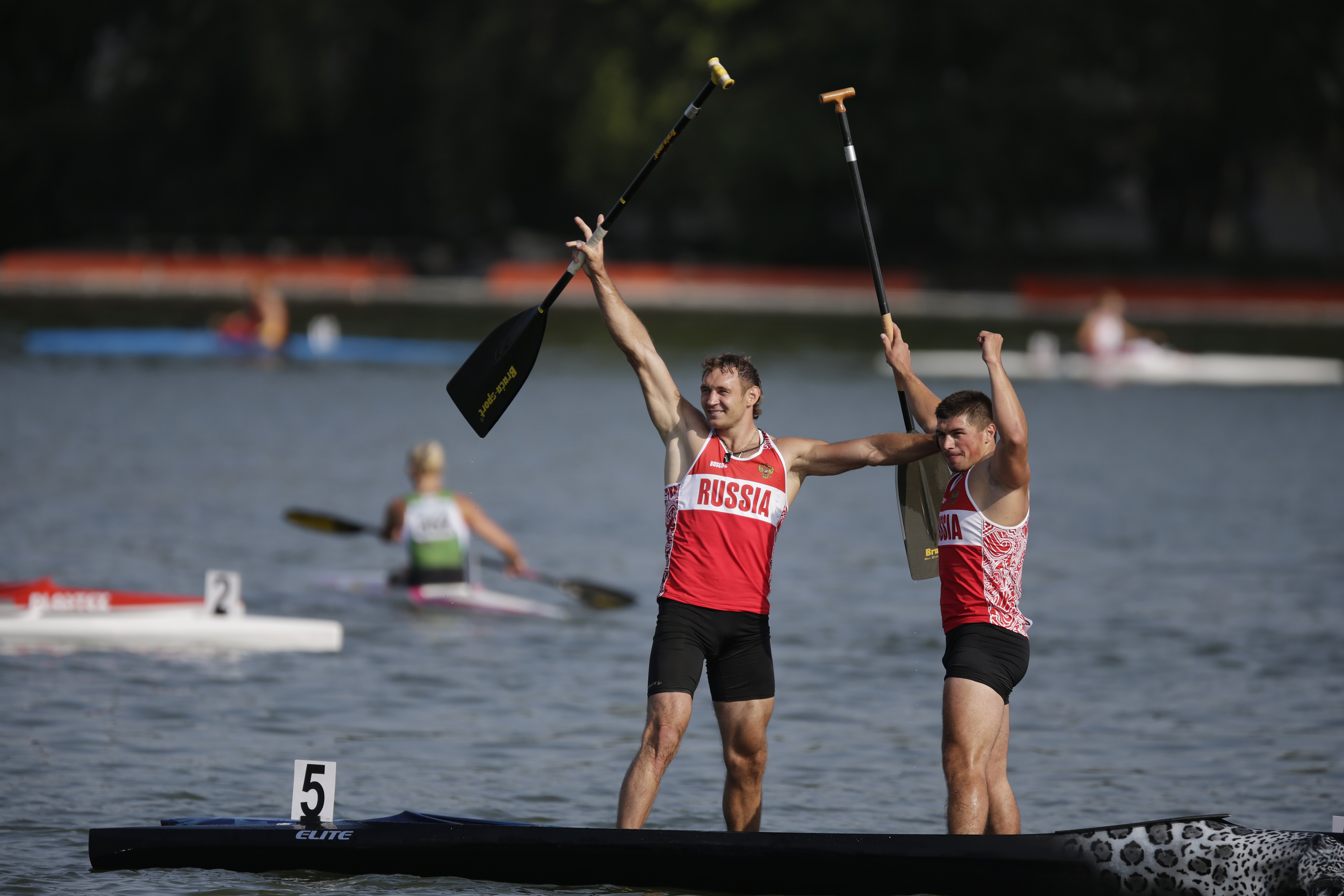 FILE In this Sunday, Aug. 10, 2014 file photo Winners Nikolay Lipkin, center, and Andrey Kraitor of Russia celebrate after they won the C1 relay men 200m final of the ICF Canoe Sprint World Championships 2014 in Moscow, Russia. The International Canoe Fed