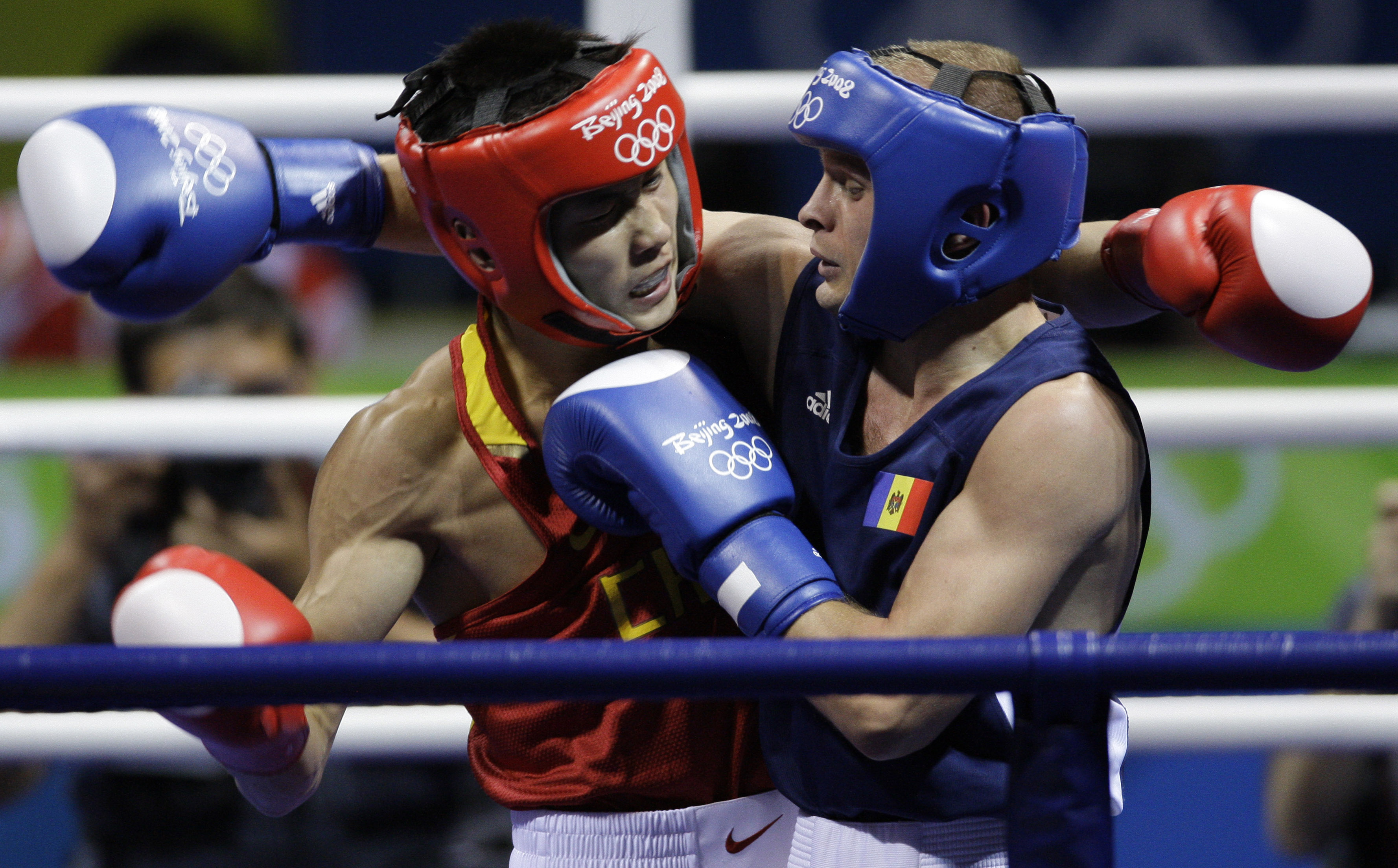 FILE - In this Aug. 15, 2008, file photo, Gu Yu of China, left, fights, Veaceslav Gojan of Moldova during a men's bantamweight 54 kilogram preliminary boxing match at the Beijing 2008 Olympics in Beijing. For the first time since 1980, men in Rio de Janei