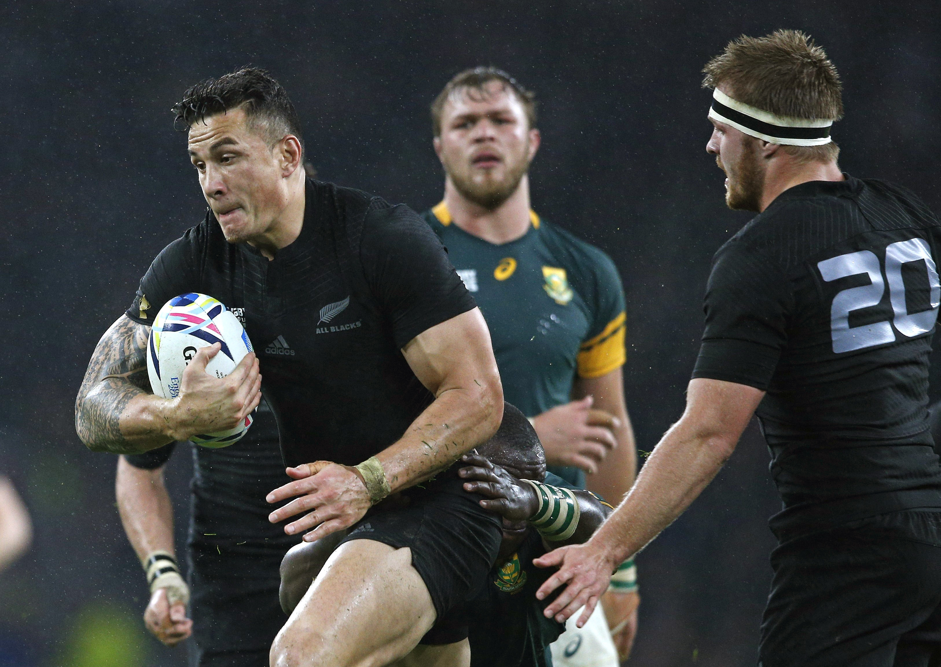 FILE - In this Oct. 24, 2015 file photo, New Zealand's Sonny Bill Williams runs with the ball during the Rugby World Cup semifinal match between New Zealand and South Africa at Twickenham Stadium in London. Williams passes for a superstar in this part of