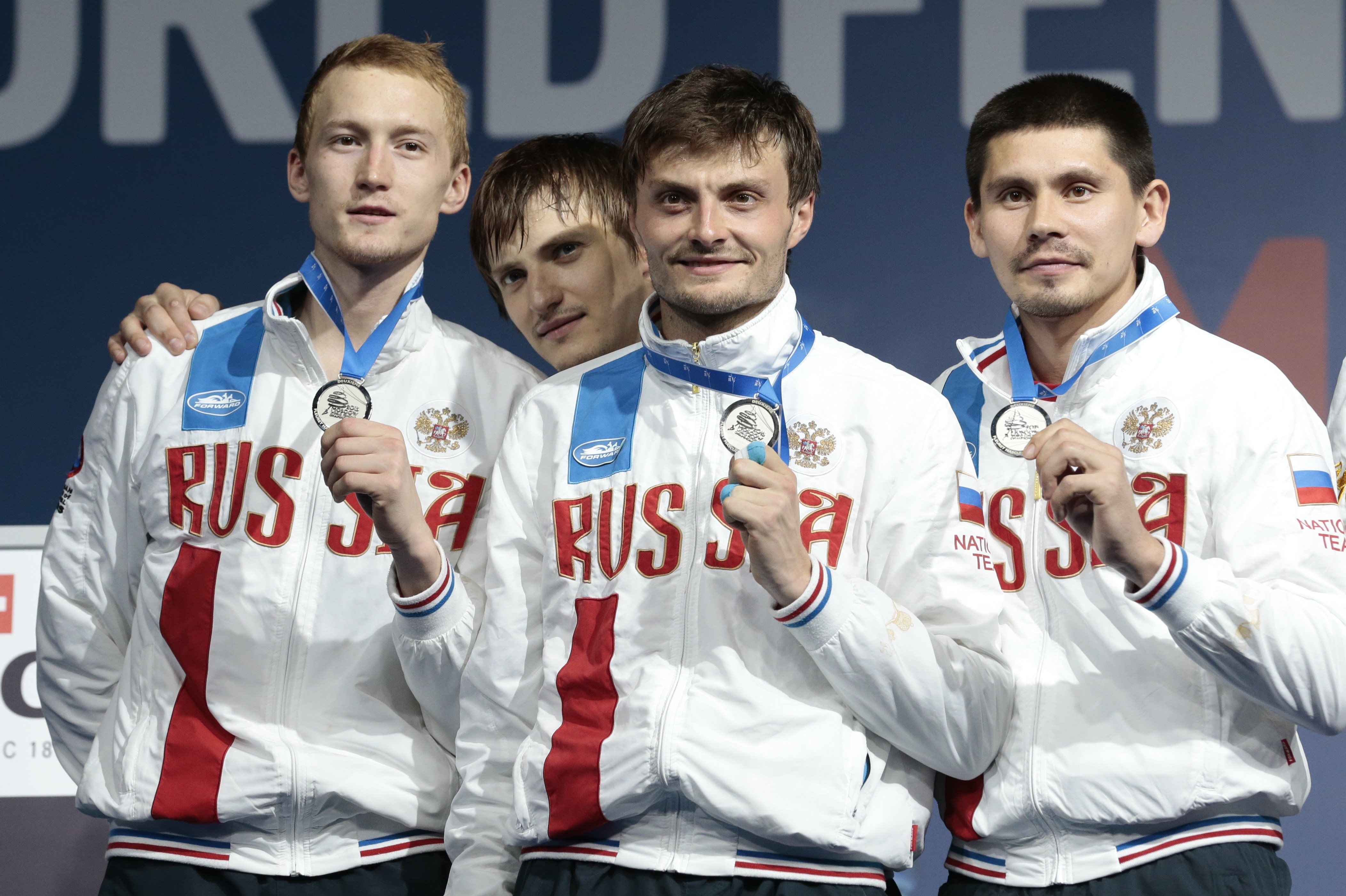 Russia team members show off their silver medals after men's team foil competition at the fencing World championships in Moscow, Russia, on Sunday, July 19, 2015. Italy won the gold, Russia took the silver and China got the bronze. (AP Photo/Ivan Sekretar