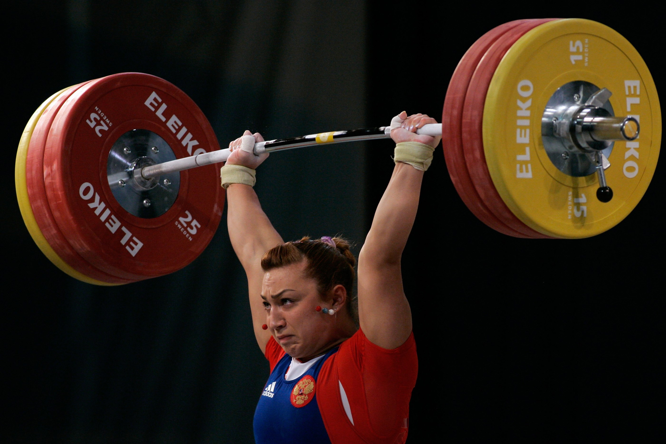 FILE - In this Saturday, April 10, 2010 file photo, Russia's Nadezhda Yevstukhina successfully lifts a weight in the Women's 75kg category, during the European Weightlifting Championship in Minsk, Belarus. Fourteen Russian athletes who competed in the 200