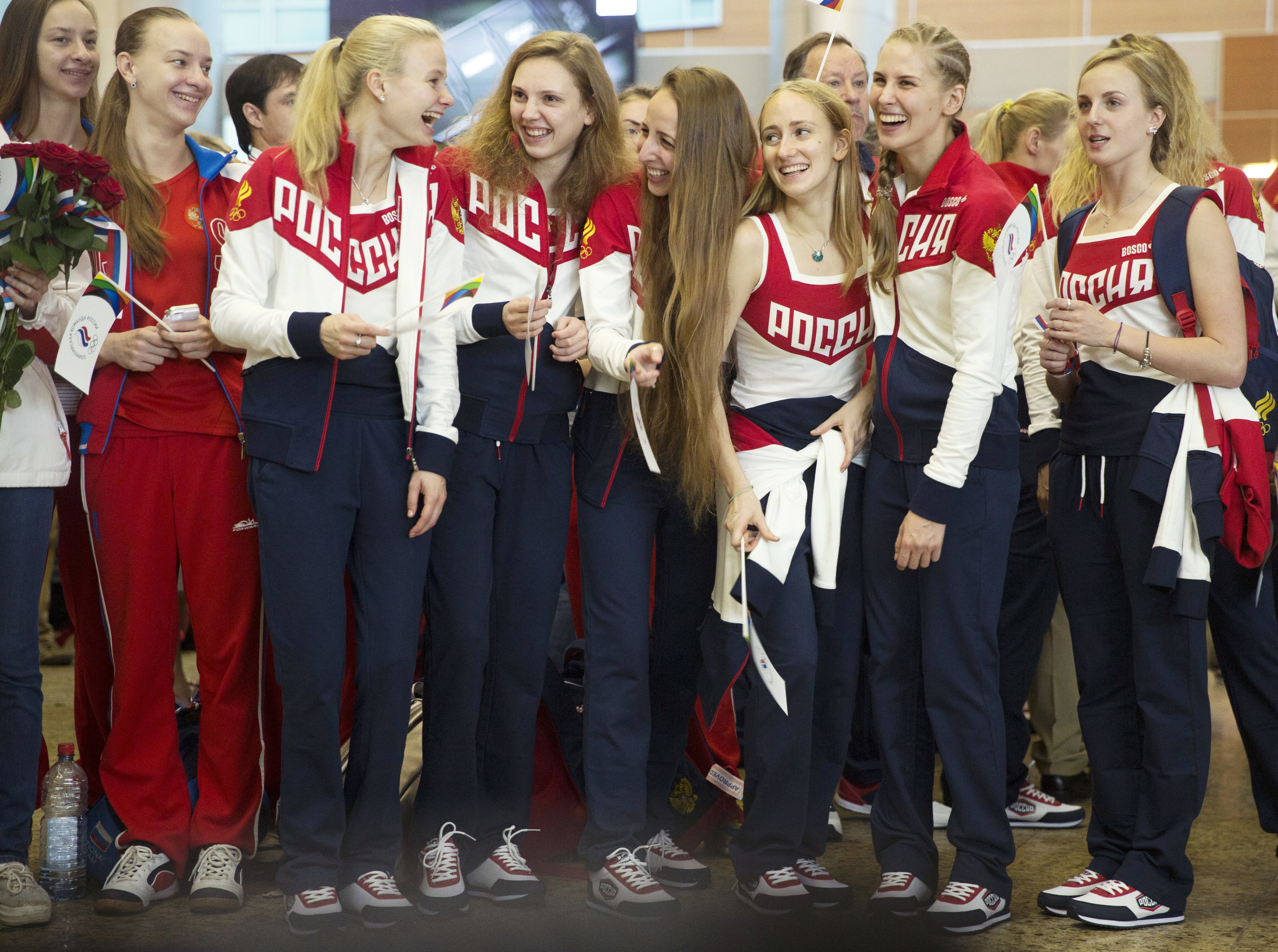 Russia's National Olympic team members attend the farewell ceremony before Russian team's departure to Rio Olympics, in Moscow's Sheremetyevo, Russia, Thursday, July 28, 2016. More than 100 Russians from the 387-strong Olympic team have been banned so far