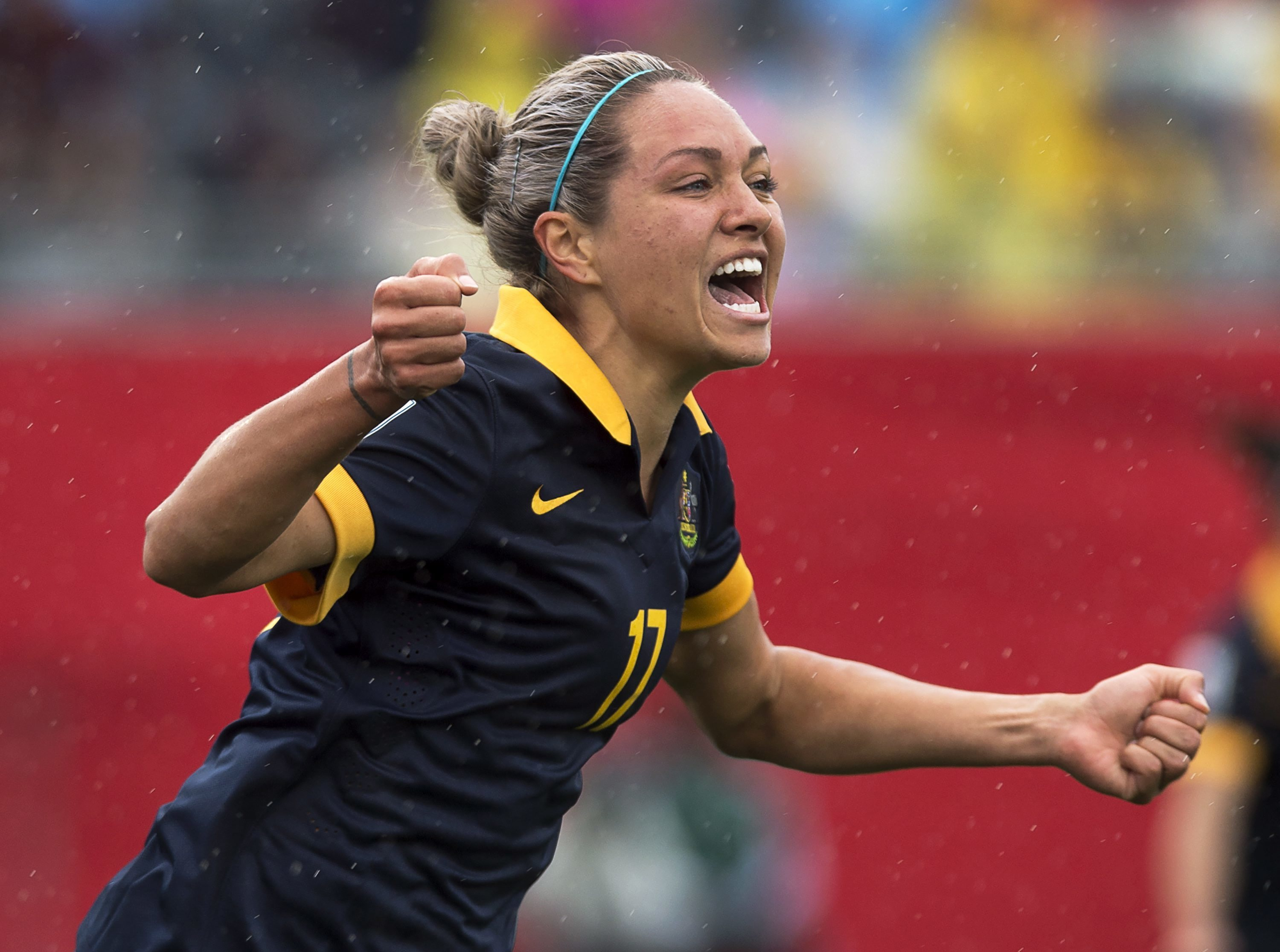 FILE - In this June 21, 2015, file photo, Australia's Kyah Simon celebrates after scoring against Brazil during the second half of a FIFA Women's World Cup soccer game in Moncton, New Brunswick. Long before the U.S. womens soccer team filed a federal comp