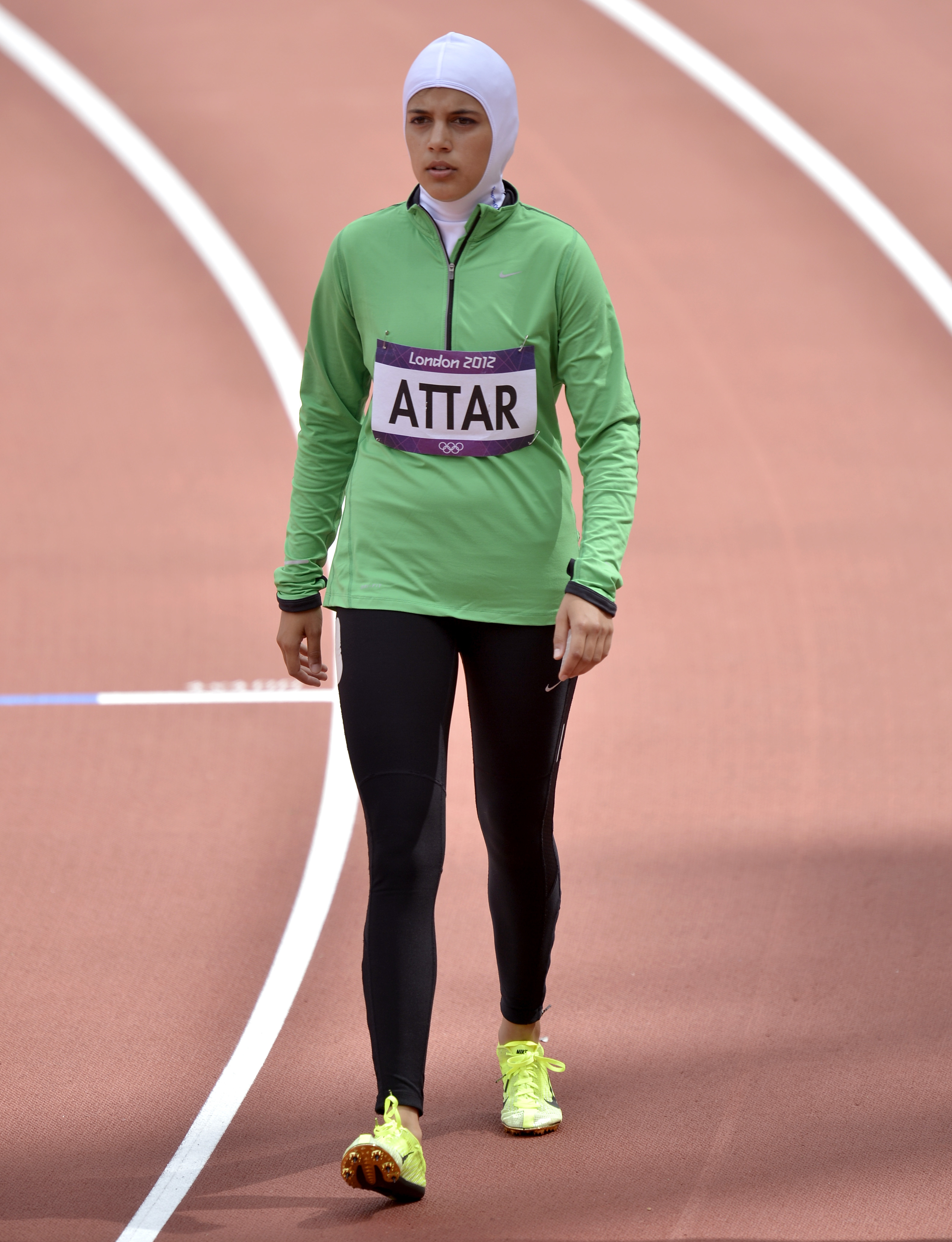 FILE -- In this Aug. 8, 2012 file photo, Saudi Arabia's Sarah Attar prepares to compete in a women's 800-meter heat during the athletics in the Olympic Stadium at the 2012 Summer Olympics, London. Saudi Arabia will send four women to the Rio de Janeiro Ol