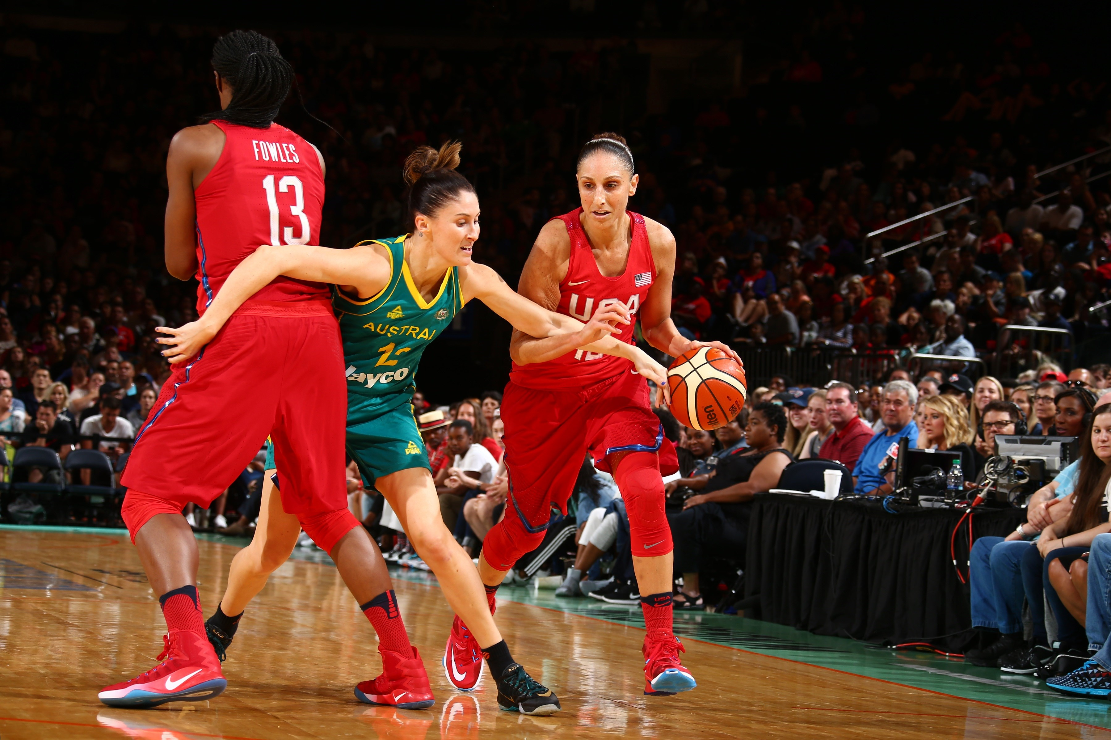 NEW YORK, NY - JULY 31:  Diana Taurasi #12 of the USA Basketball Women's National Team moves the ball against Katie Rae Ebzery #12 of Australia on July 31, 2016 at Madison Square Garden in New York, New York. (Photo by Nathaniel S. Butler/NBAE via Getty I