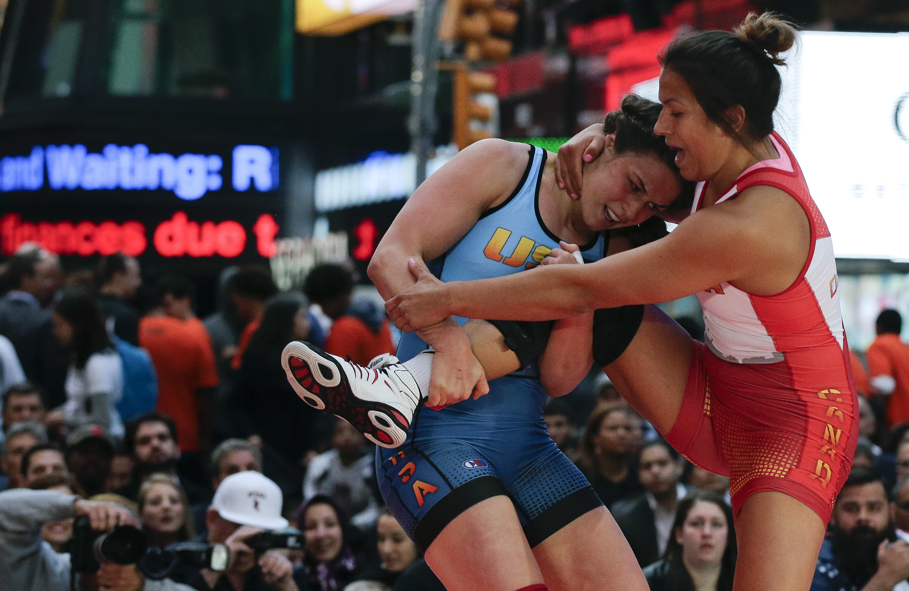 FILE - In this May 19, 2016, file photo, Adeline Gray, left, attempts to take down Canada's Justina Di Stasio during the Beat the Streets wrestling exhibition in Times Square in New York. Gray is ranked No. 1 at 75 kilograms (165 pounds) and will attempt