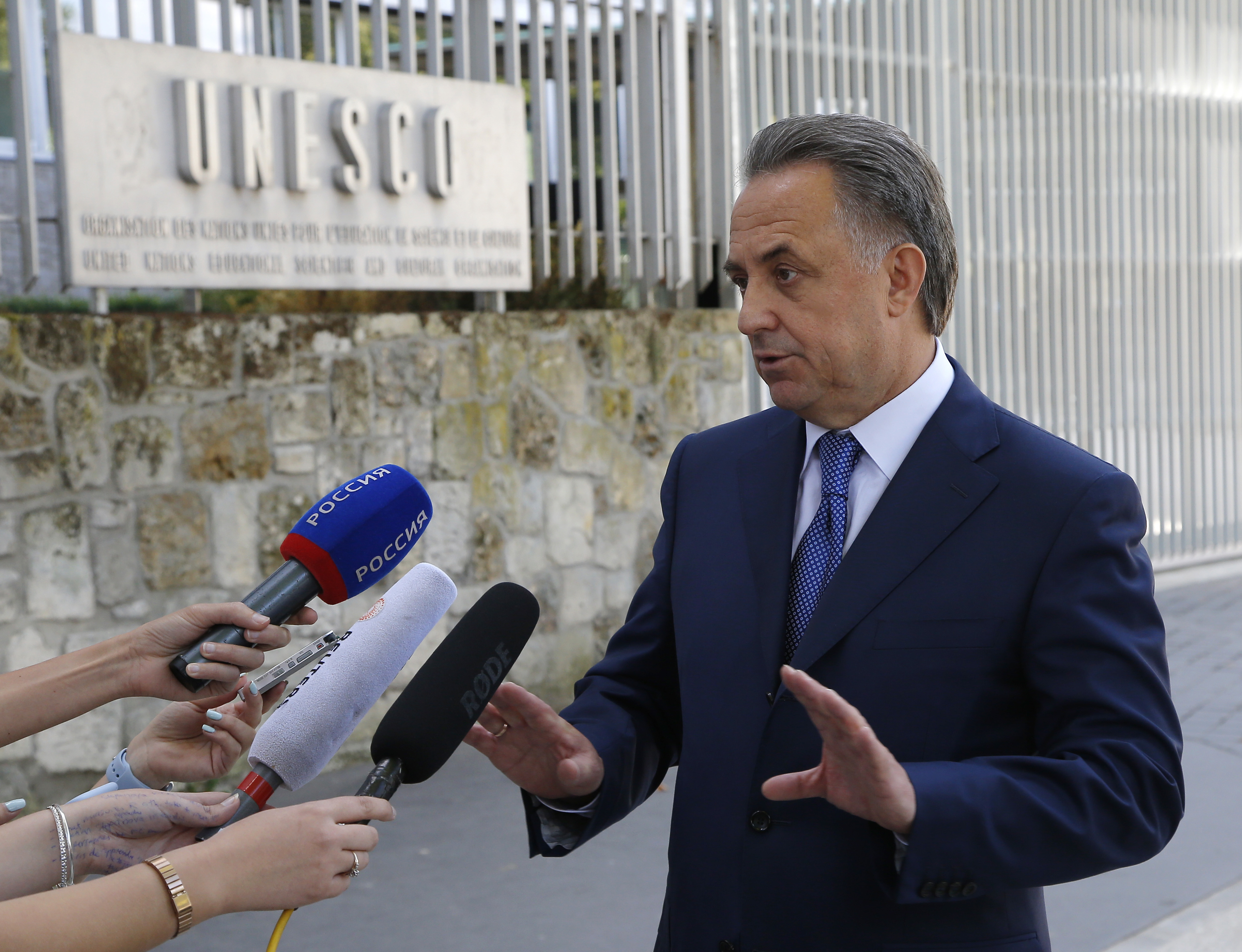 Russian Sports Minister Vitaly Mutko answers reporters after a meeting with the working group, the Bureau for the convention on anti-doping, at the Unesco headquarters in Paris, Monday, Aug. 1, 2016. (AP Photo/Michel Euler)
