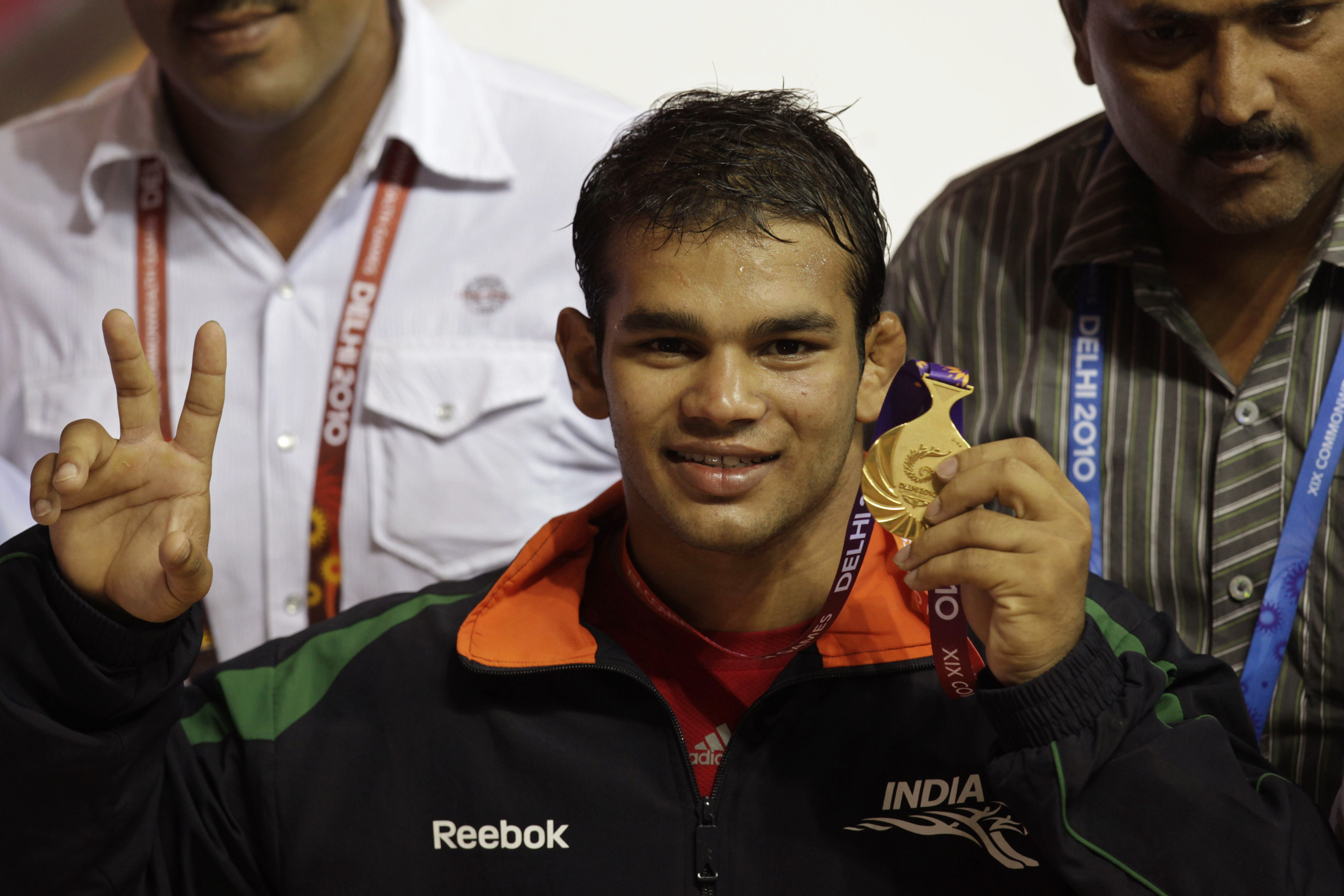 FILE- In this Oct. 9, 2010, file photo, Indian wrestler Narsingh Yadav displays his medal after winning against South Africa Richard Brian Addinall in the 74kg category wrestling at the Commonwealth Games in New Delhi, India. Yadav, who was to represent I