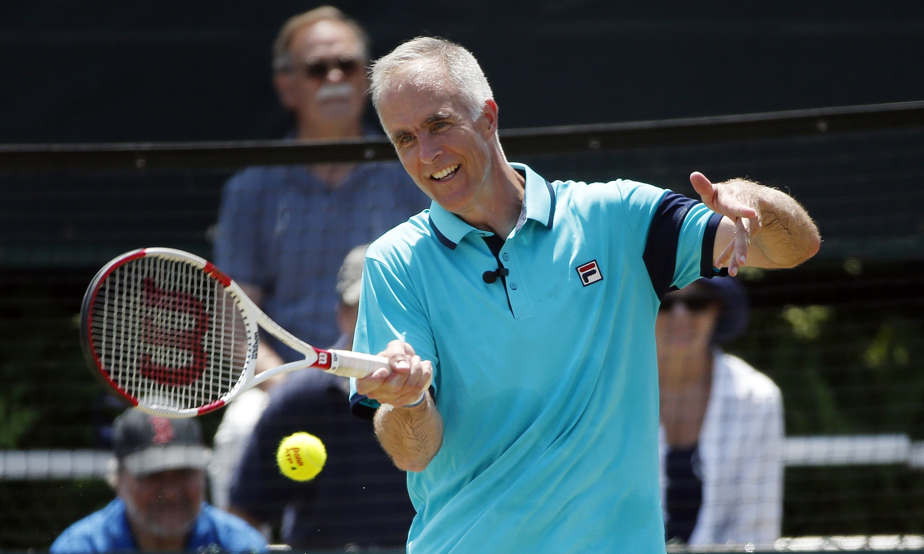 FILE - In this July 19, 2015, file photo, International Tennis Hall of Fame CEO Todd Martin plays in an exhibition doubles match at the Hall of Fame in Newport, R.I. Martin, who calls barely missing out on the chance to represent the U.S. in singles at At