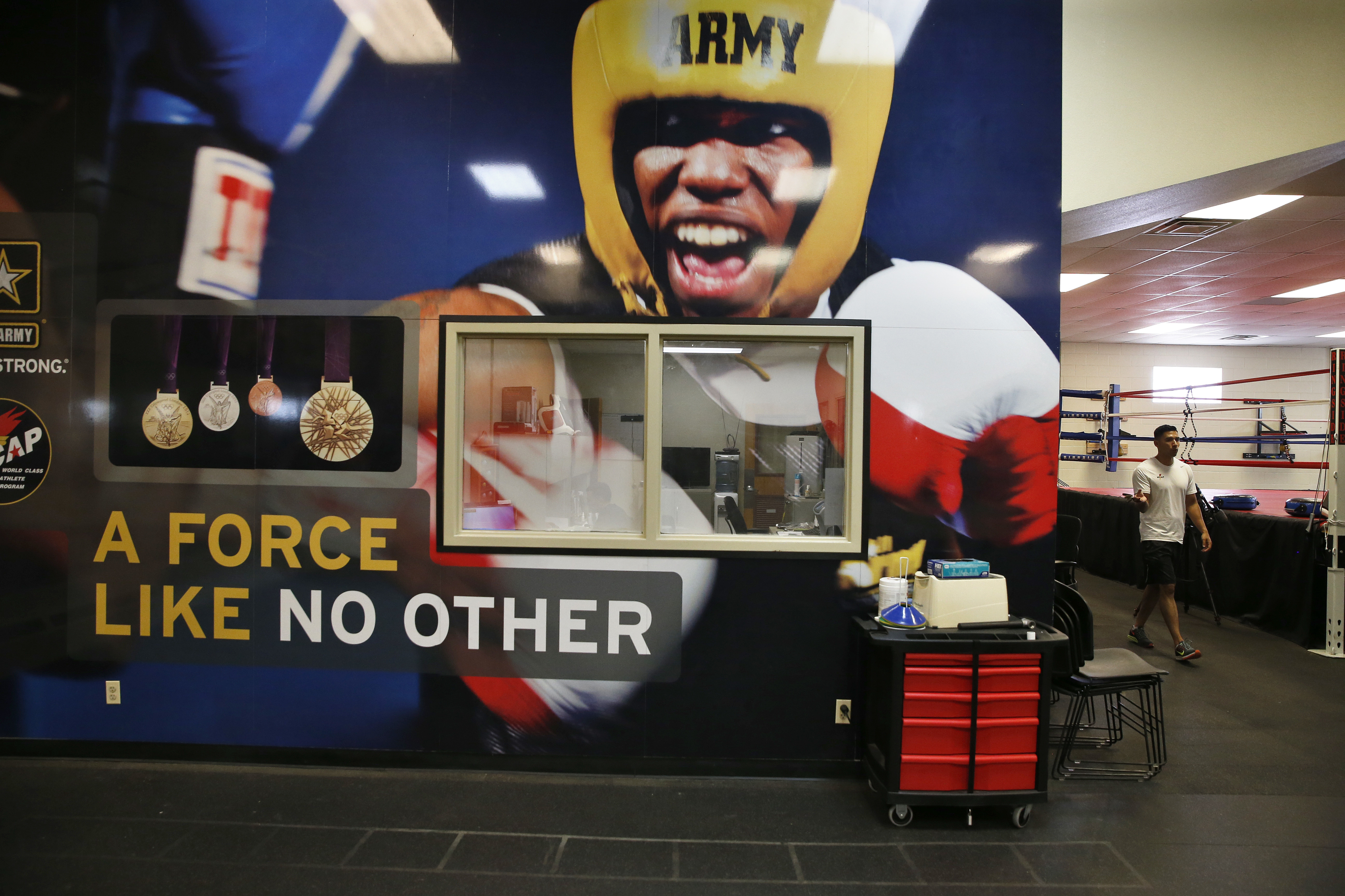 In this July 19, 2016 photo, a mural covers a wall in a gym inside the U.S. Army's World Class Athlete Program, at Fort Carson Army Base, outside Colorado Springs, Colo. About a dozen Army athletes are to compete for the United States at the Rio Olympics.