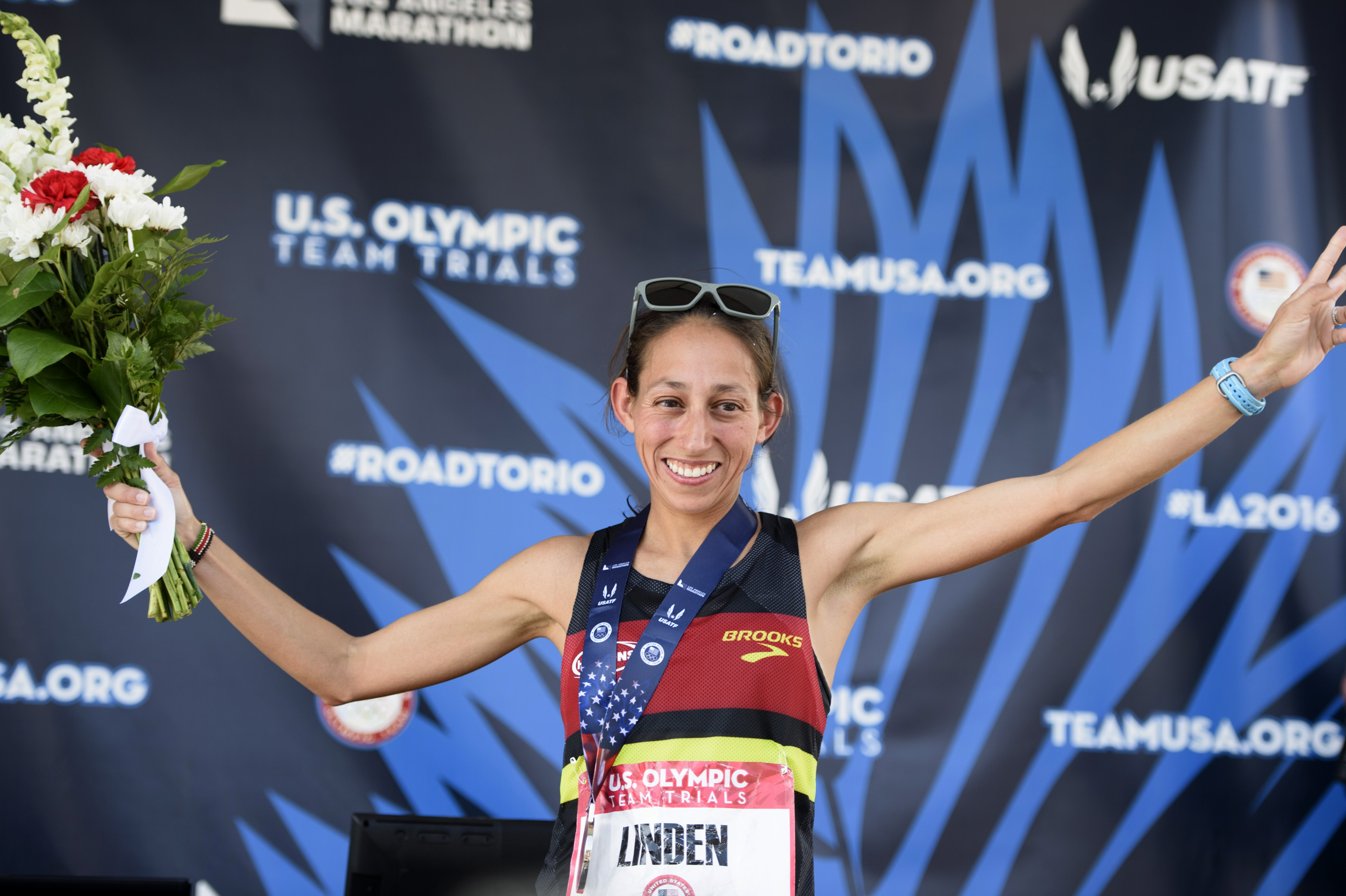 Desiree Linden reacts on the podium during the U.S. Olympic marathon trials, Saturday, Feb. 13, 2016, in Los Angeles. (AP Photo/Kelvin Kuo)