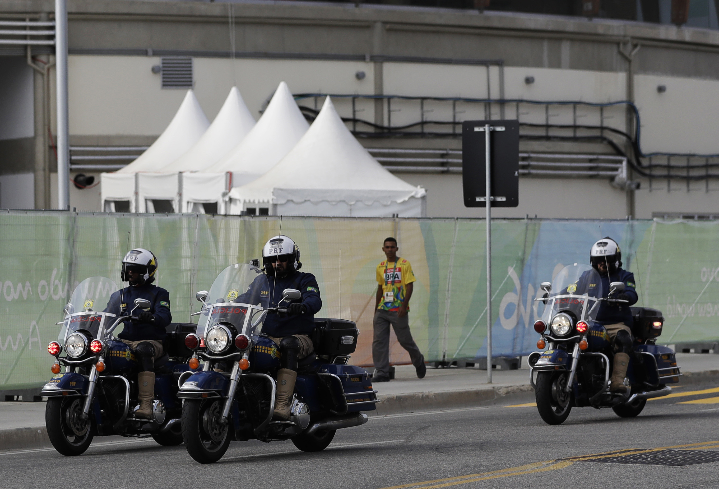 Motorcycle police ride along a road inside the Olympic Park, ahead of the 2016 Summer Olympics in Rio de Janeiro, Brazil, Tuesday, Aug. 2, 2016. (AP Photo/Rebecca Blackwell)