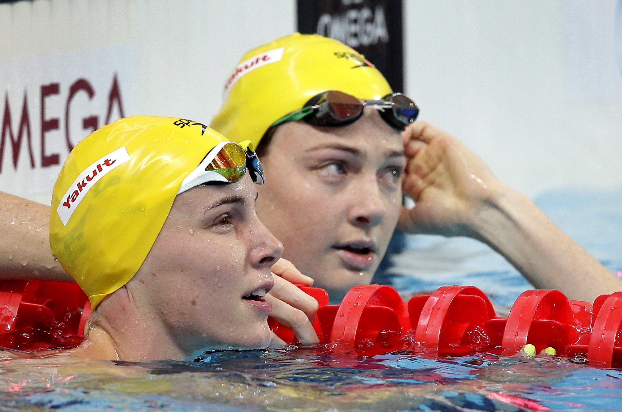 FILE - In this Aug. 8, 2015, file photo, Australia's Bronte Campbell, left, and her sister Cate Campbell, right, look at results after a women's 50-meter freestyle heat at the Swimming World Championships in Kazan, Russia. The two are both leading medal c