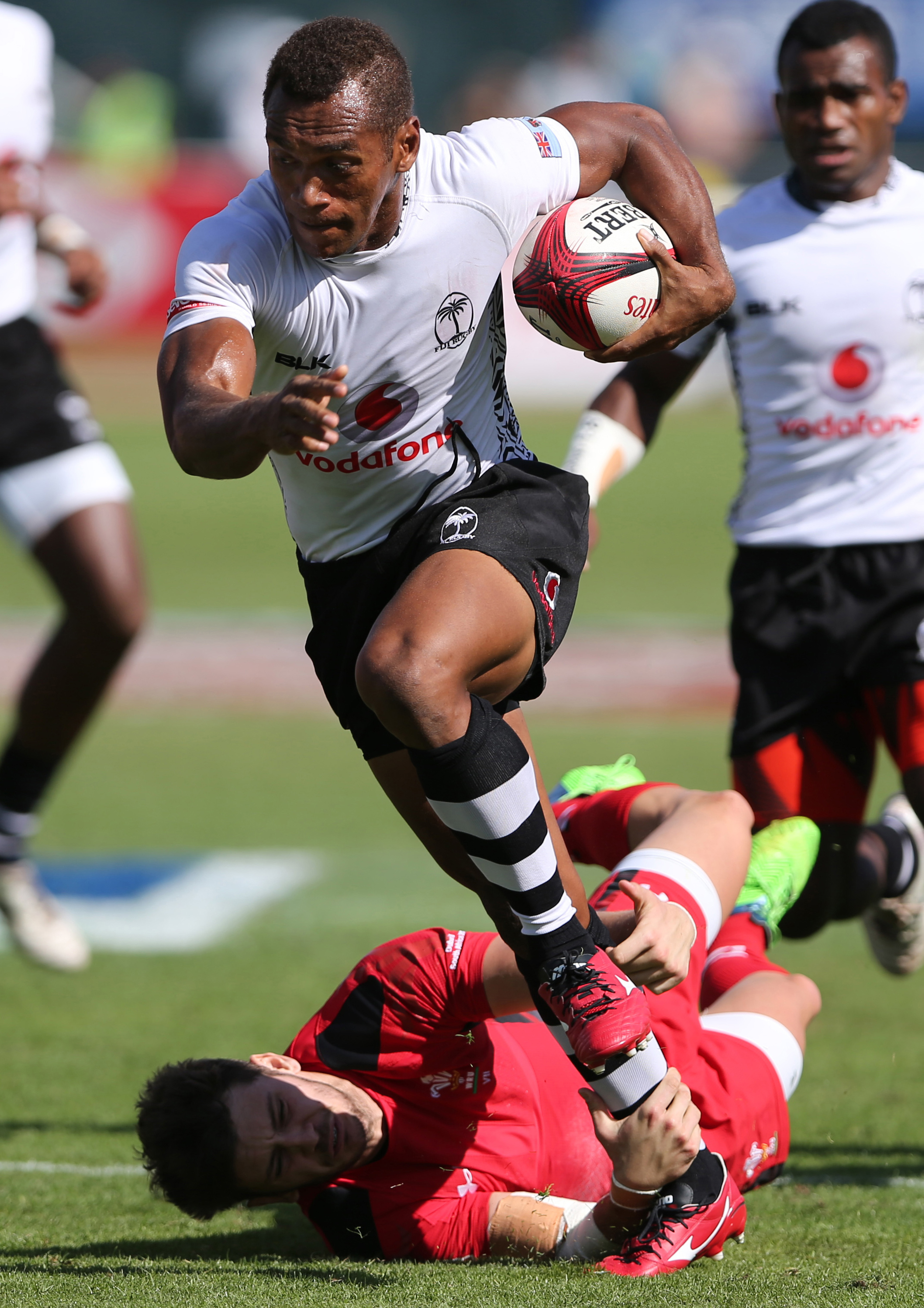 In this Dec. 6, 2014, file photo, Fiji's Osea Kolinisau runs with the ball during a quarter final match of Sevens World Series against Wales in Dubai, United Arab Emirates. The inspirational Kolinisau will lead the men's team, after he has carried the Fij