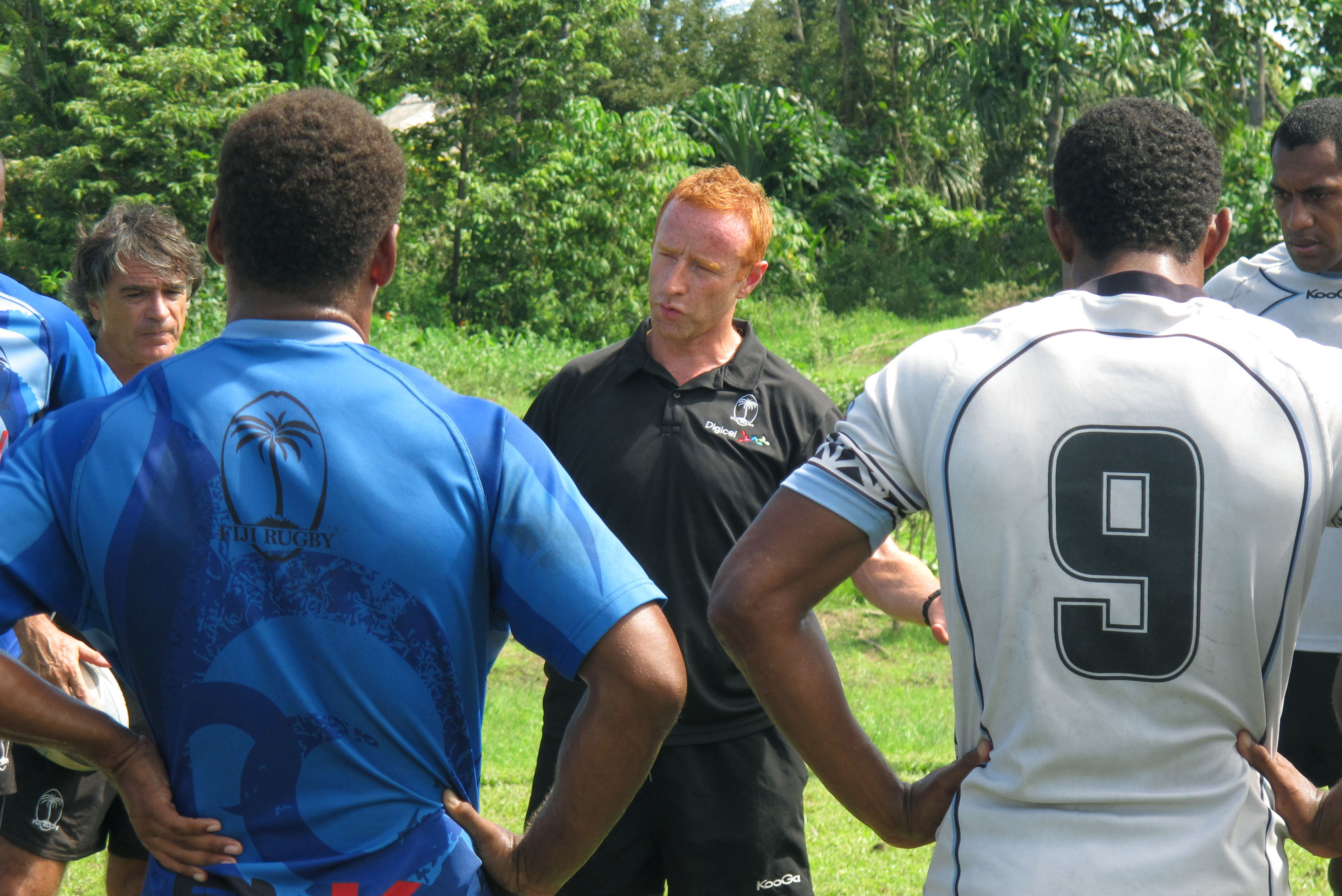 In this , Nov. 7, 2013, file photo, Fiji rugby sevens coach Ben Ryan, center, speaks to his squad in Pacific Harbour, Fiji. Since moving from England in 2013, Ryan has harnessed the passion Fijians have for their kind of football, reinforcing the connecti