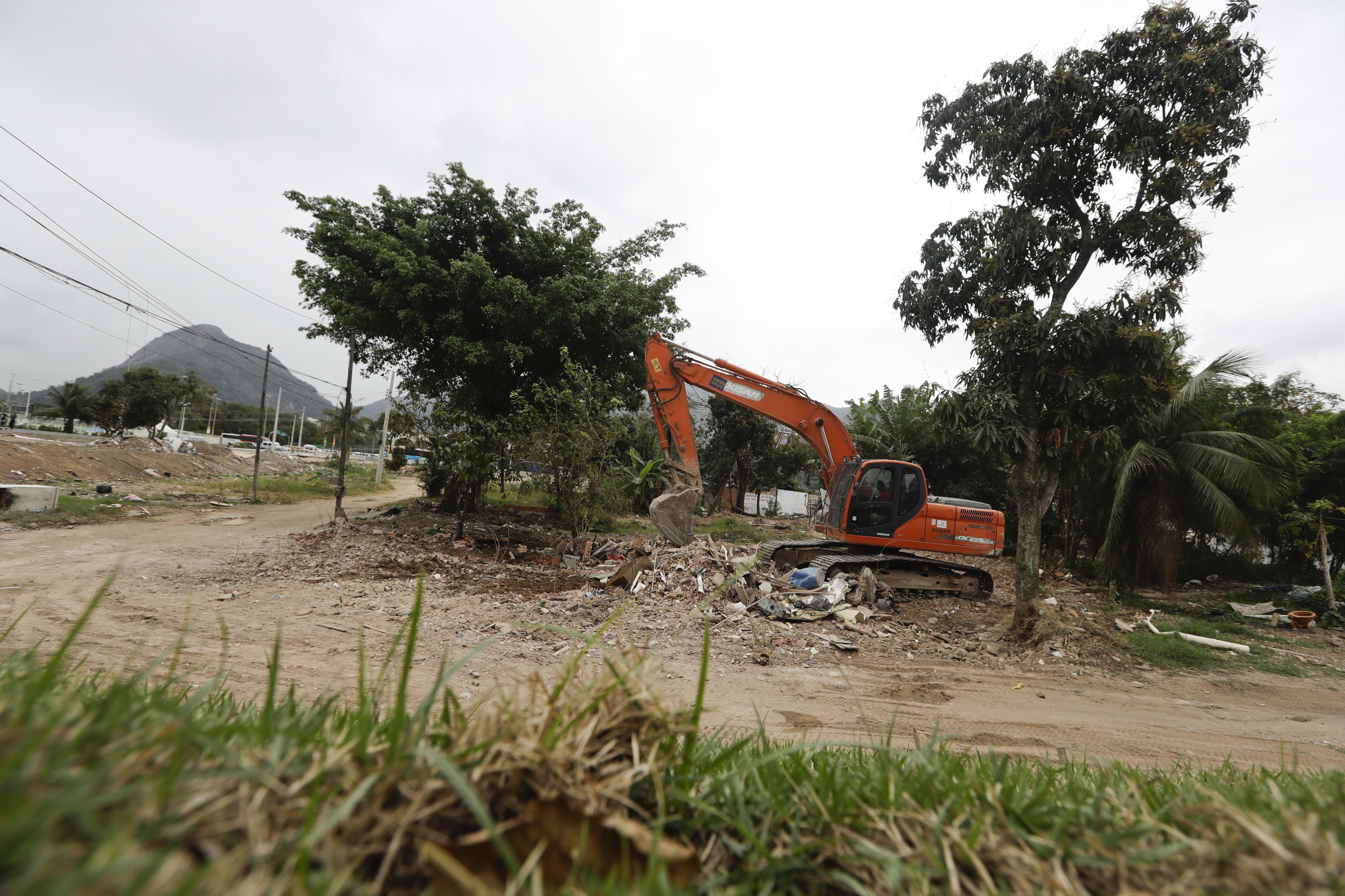 A crane stands where the last house was destroyed near the Olympic Park ahead of the 2016 Summer Olympics in Rio de Janeiro, Brazil, Wednesday, Aug. 3, 2016. (AP Photo/Frank Franklin II)