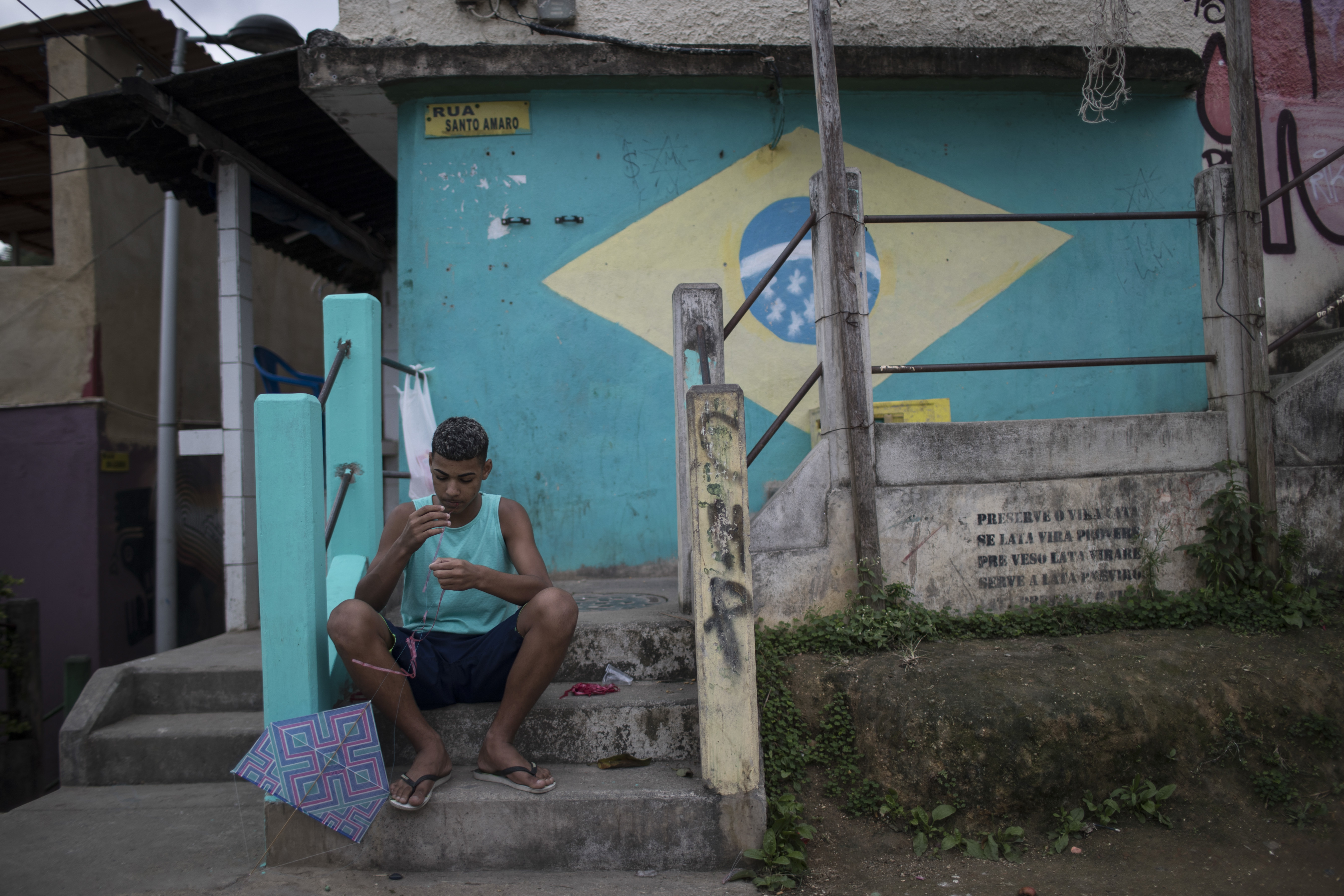 A Boy prepares his kite before flying it at the Babilonia slum in Rio de Janeiro, Brazil, Wednesday, Aug. 3, 2016. The Olympics are scheduled to open Aug. 5. (AP Photo/Felipe Dana)