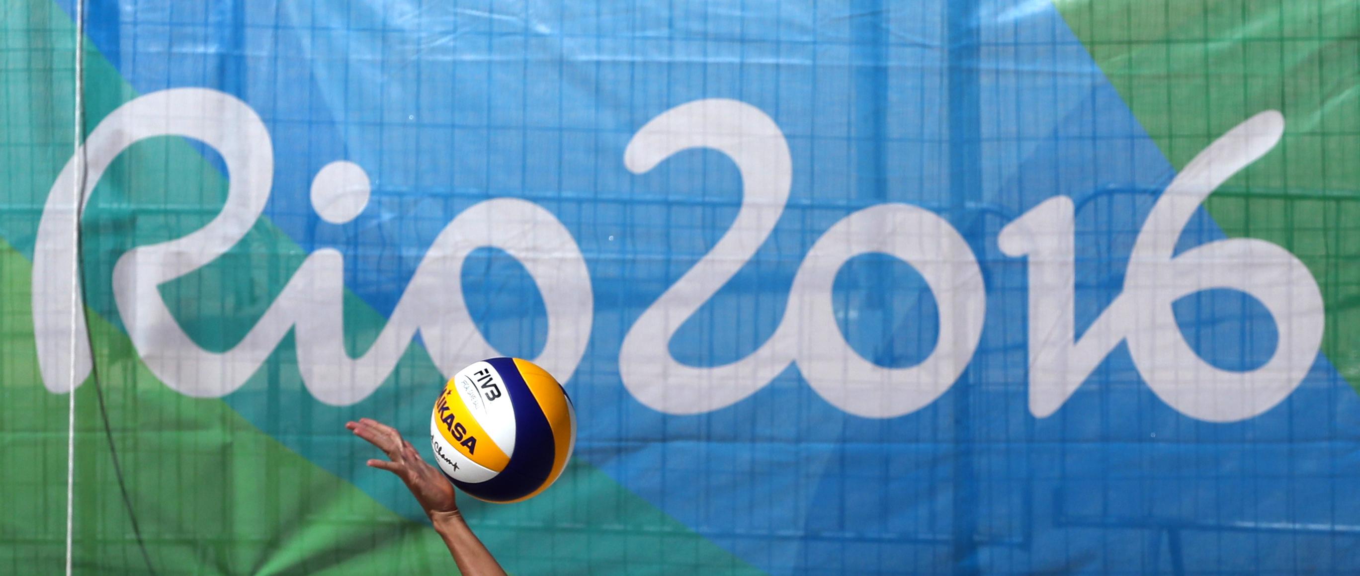 An athlete serves a ball during her training at the Copacabana beach volleyball arena prior the 2016 Summer Olympics in Rio de Janeiro, Brazil, Thursday, Aug. 4, 2016. (AP Photo/Petr David Josek)