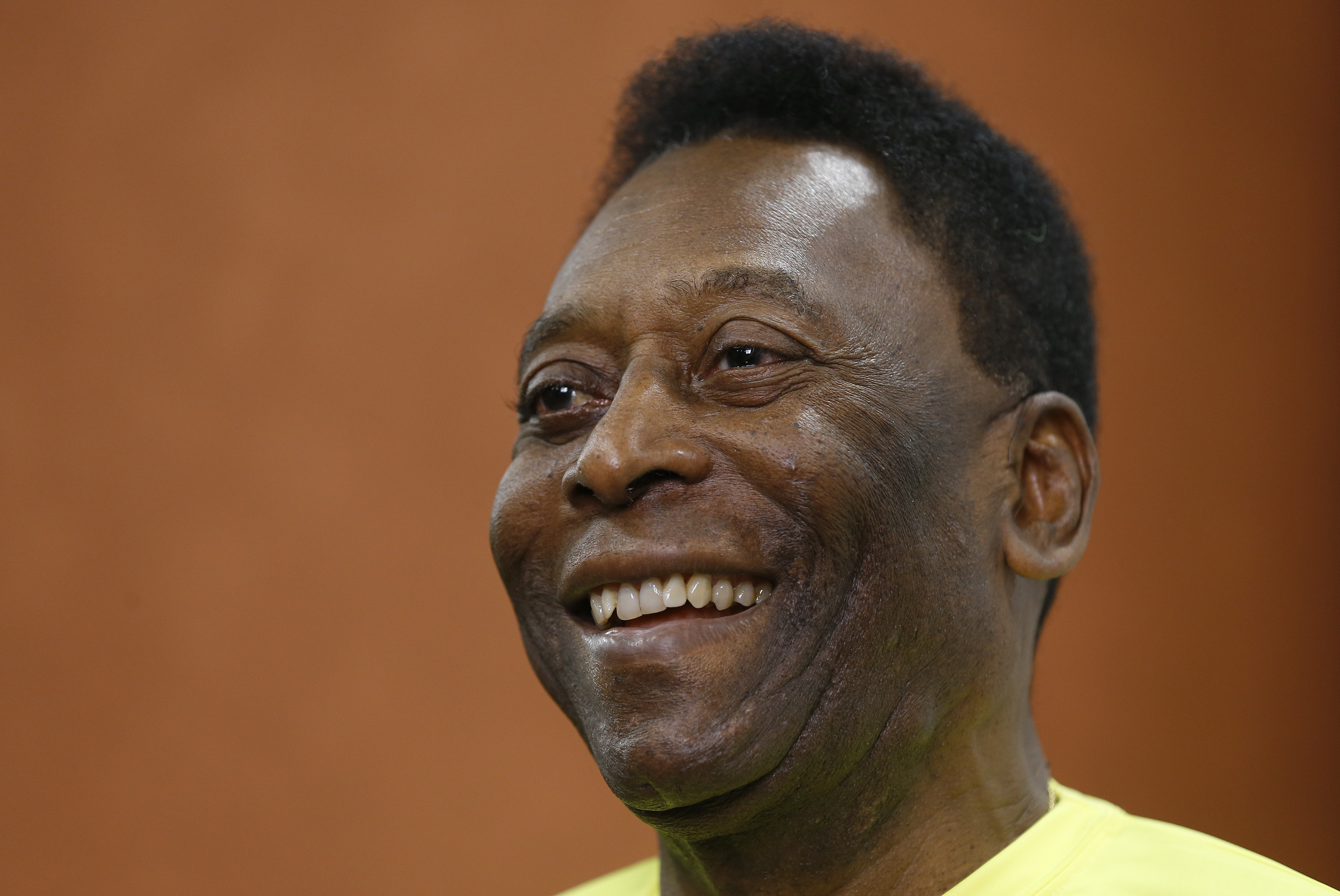 FILE - In this March 20, 2015 file photo, Brazilian soccer legend Pele smiles during a media opportunity at a restaurant in London. Pele said on Friday, Aug. 5, 2016 that his poor health will keep him from attending the opening ceremony of the Rio Olympic