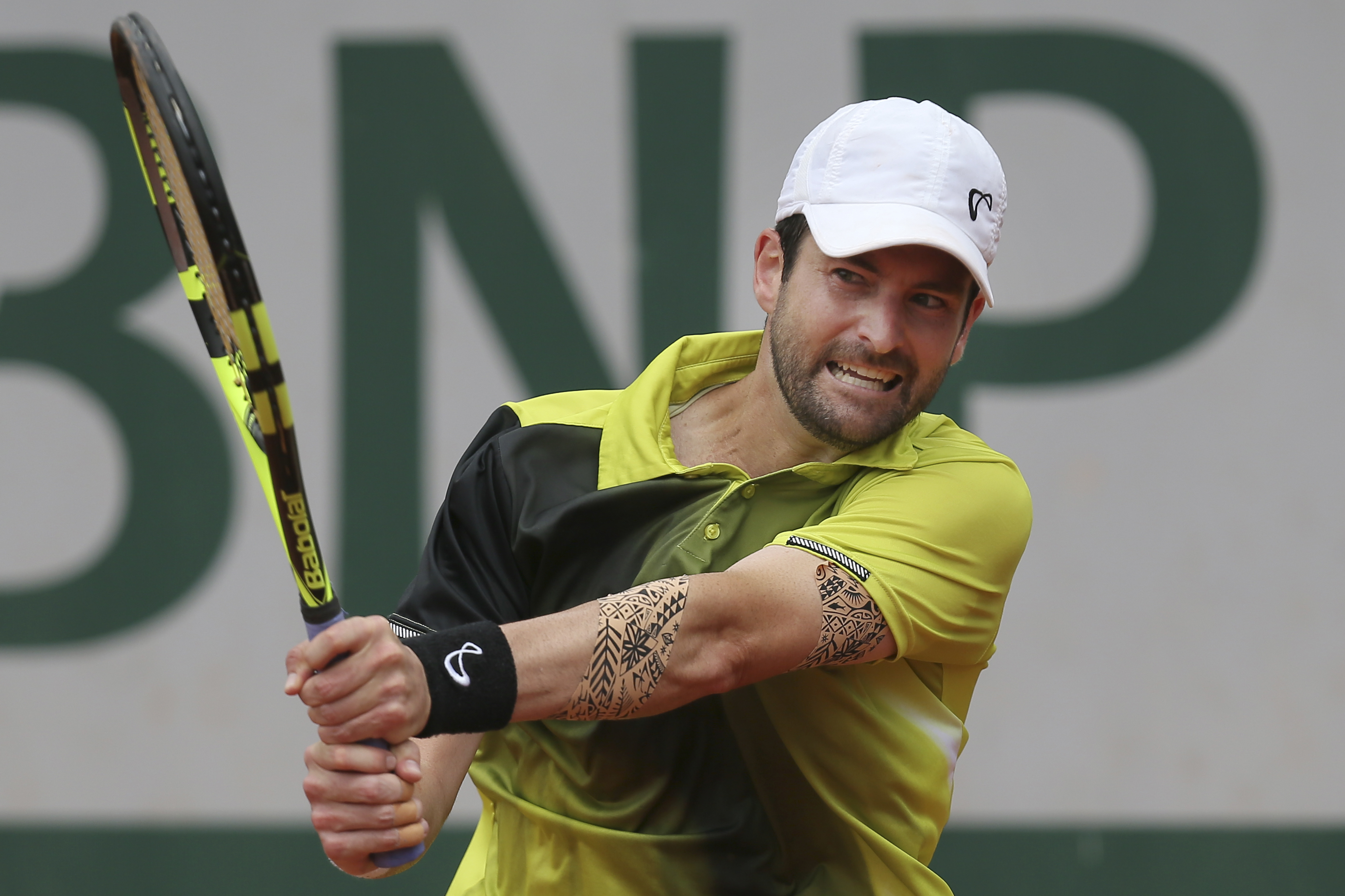 FILE - In this May 24, 2016 file photo, Brian Baker of the U.S. returns in his first round match of the French Open tennis tournament against Australia's Bernard Tomic at the Roland Garros stadium in Paris, France.  Baker, whose promising career has been