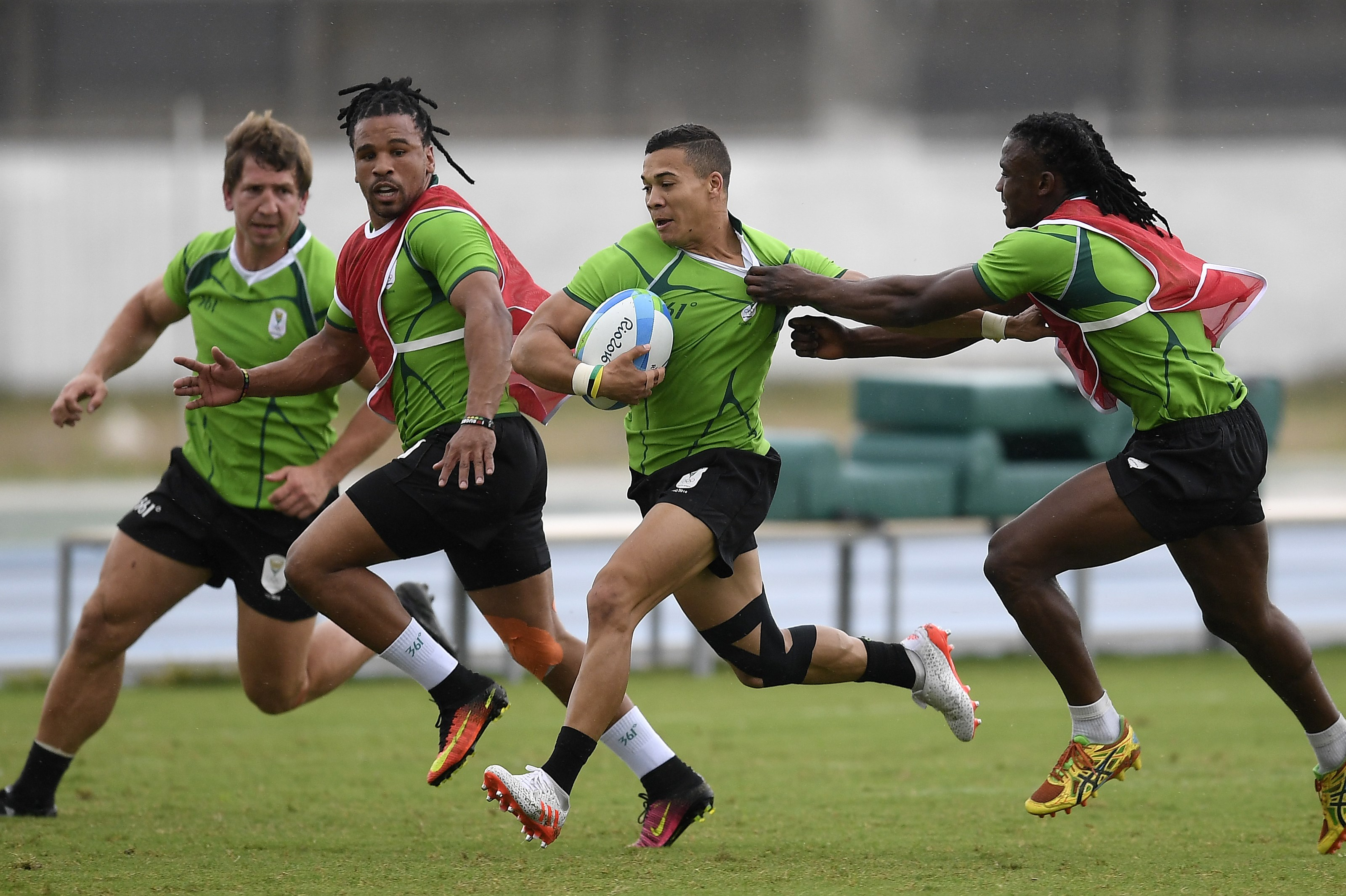 South Africa's Cheslin Kolbe runs with the ball during a men's rugby sevens team training session ahead of the 2016 Summer Olympics in Rio de Janeiro, Brazil, Wednesday, Aug. 3, 2016. (AP Photo/Martin Meissner)