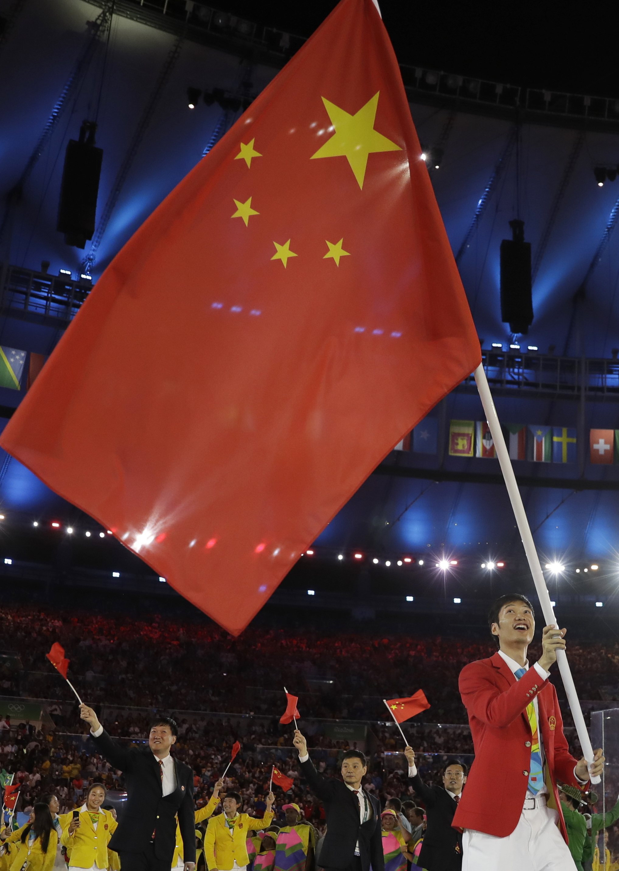Lei Sheng carries the flag of China during the opening ceremony for the 2016 Summer Olympics in Rio de Janeiro, Brazil, Friday, Aug. 5, 2016. (AP Photo/David J. Phillip)