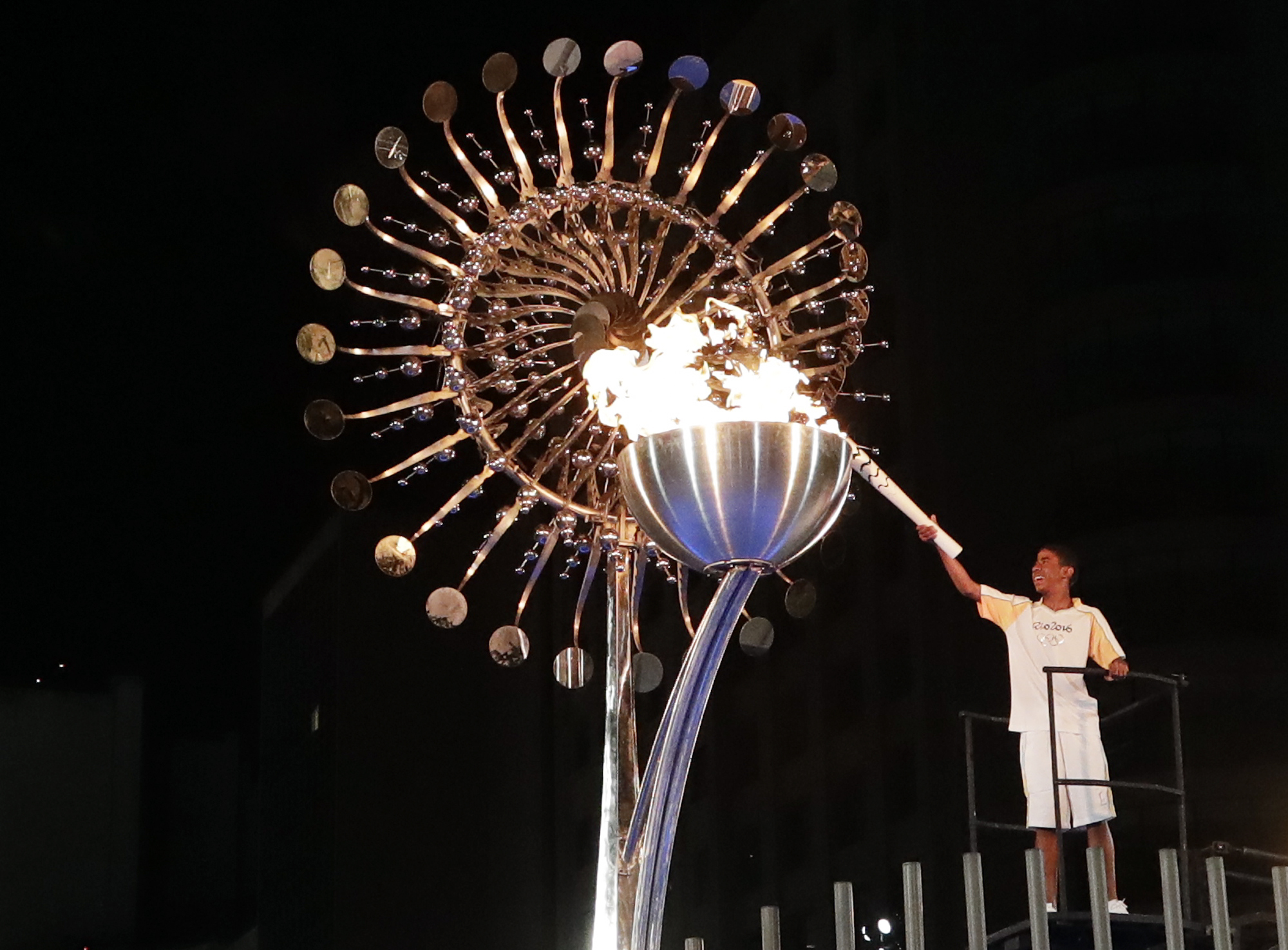 Jorge Alberto Oliveira Gomes lights the Olympic cauldron during the opening ceremony of the 2016 Summer Olympics in Rio de Janeiro, Brazil, Saturday, Aug. 6, 2016. (AP Photo/Gregory Bull)