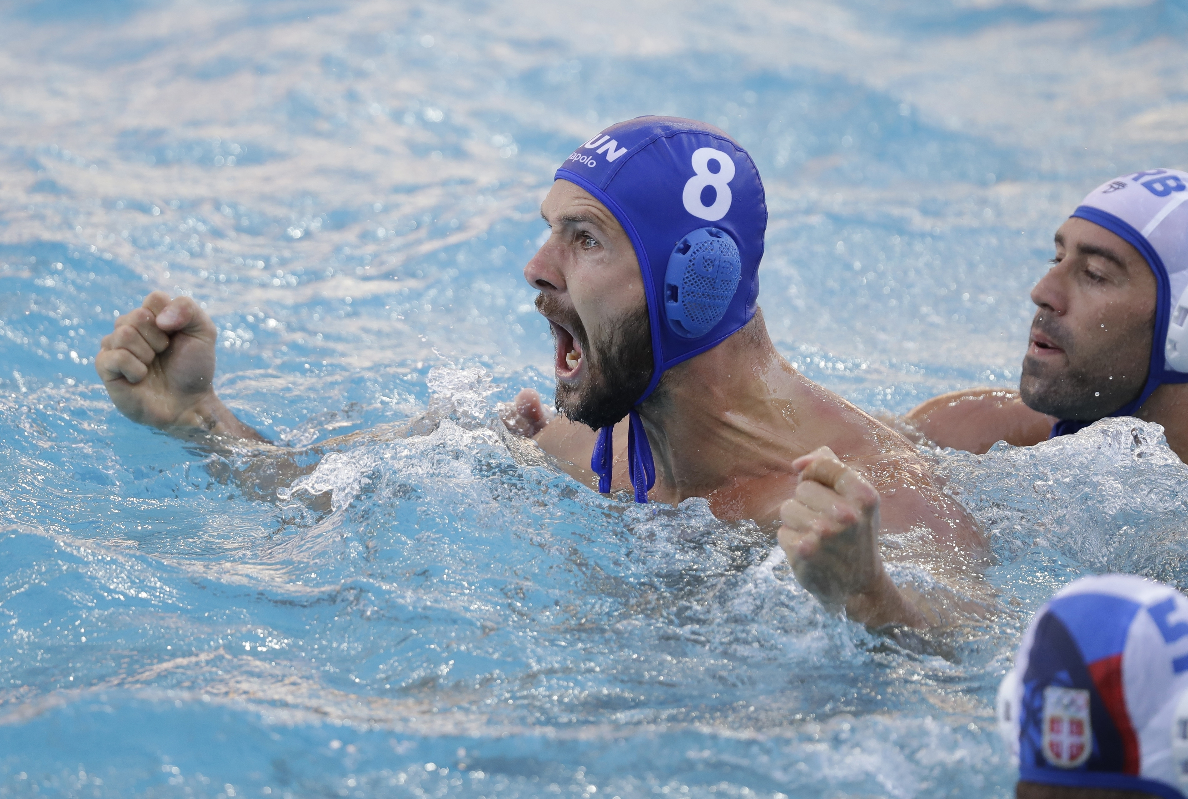 Hungary???s Marton Szivos reacts to a goal against Serbia during a preliminary men's water polo match at the 2016 Summer Olympics in Rio de Janeiro, Brazil, Saturday, Aug. 6, 2016. (AP Photo/Sergei Grits)