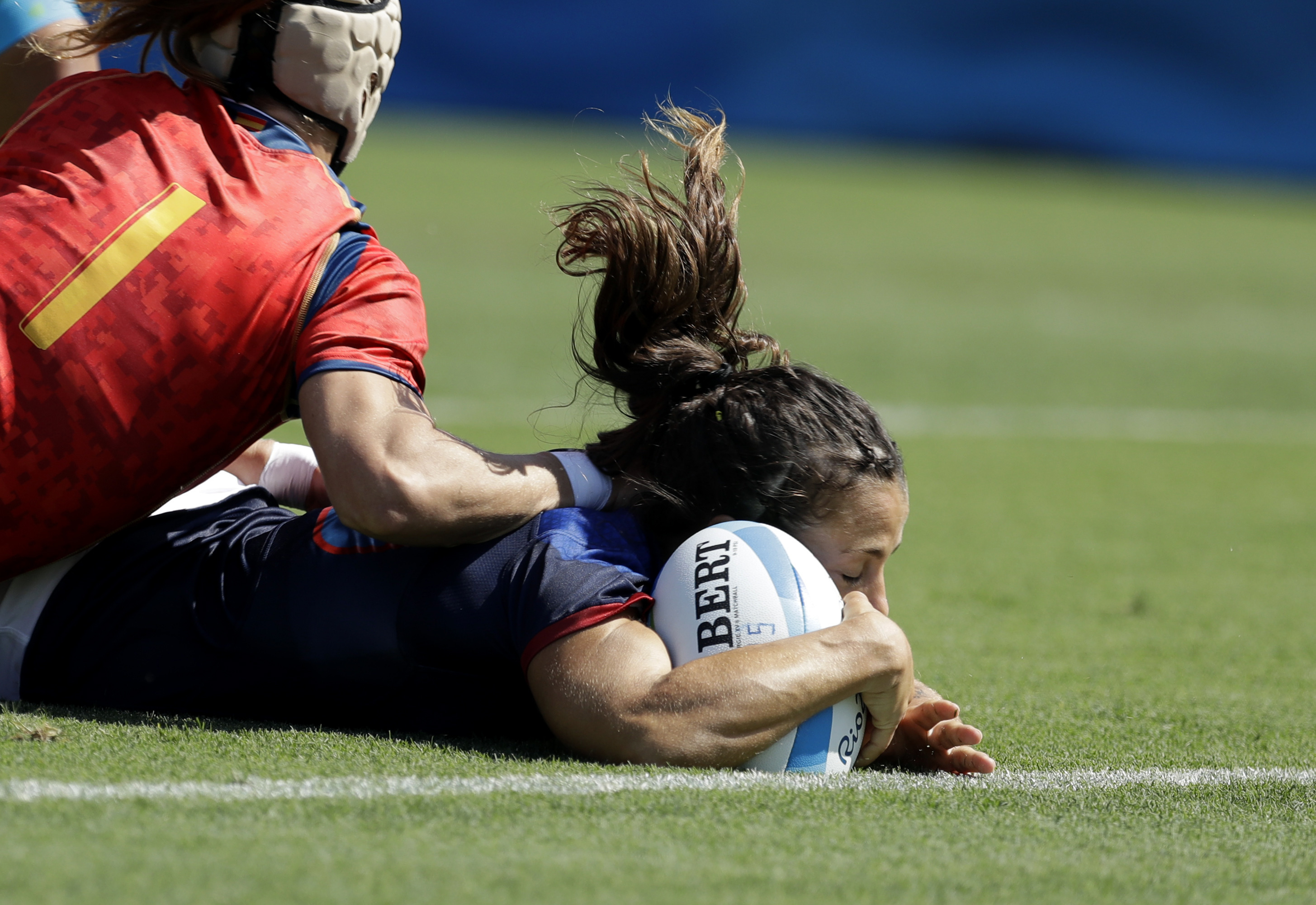 France's Elodie Guiglion, scores a try during the women's rugby sevens match between France and Spain at the Summer Olympics in Rio de Janeiro, Brazil, Saturday, Aug. 6, 2016. (AP Photo/Themba Hadebe)