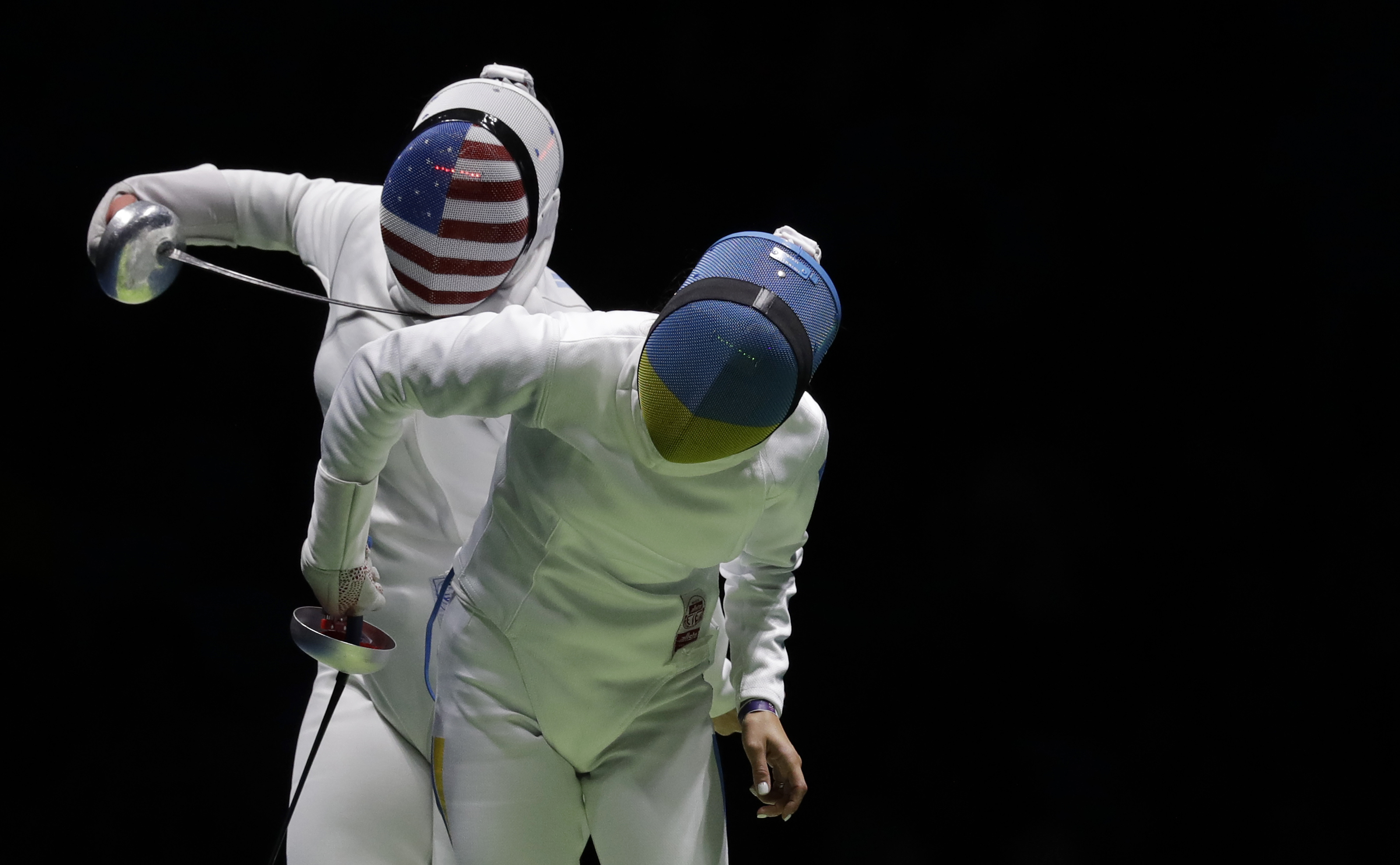 Courtney Hurley of the United States, left, and Yana Shemyakina of Ukraine compete in the women's individual epee event at the 2016 Summer Olympics in Rio de Janeiro, Brazil, Saturday, Aug. 6, 2016. (AP Photo/Andrew Medichini)