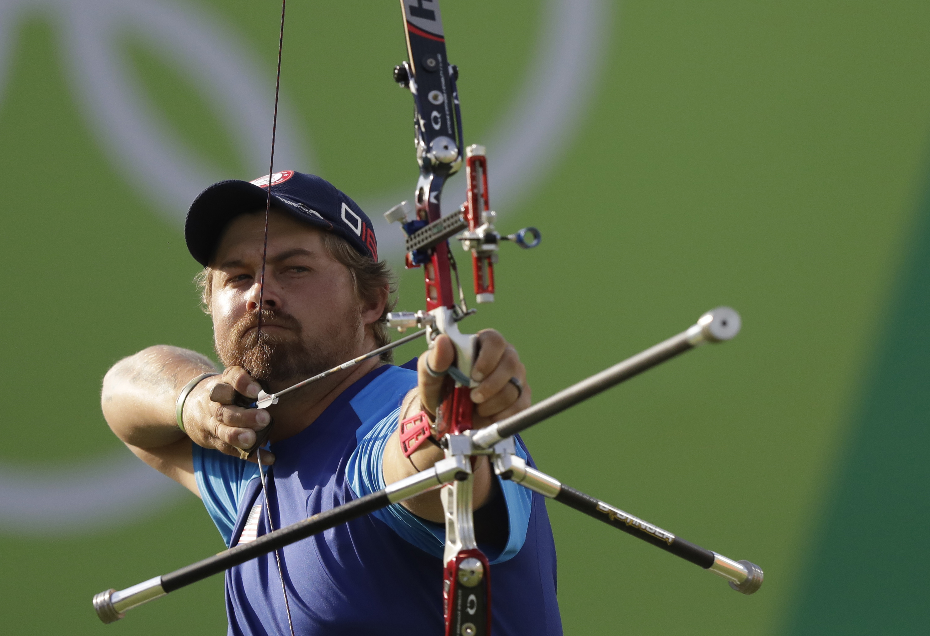 Brady Ellison of the United States aims for the target during the men's team archery competition at the Sambadrome venue during the 2016 Summer Olympics in Rio de Janeiro, Brazil, Saturday, Aug. 6, 2016.(AP Photo/Natacha Pisarenko)