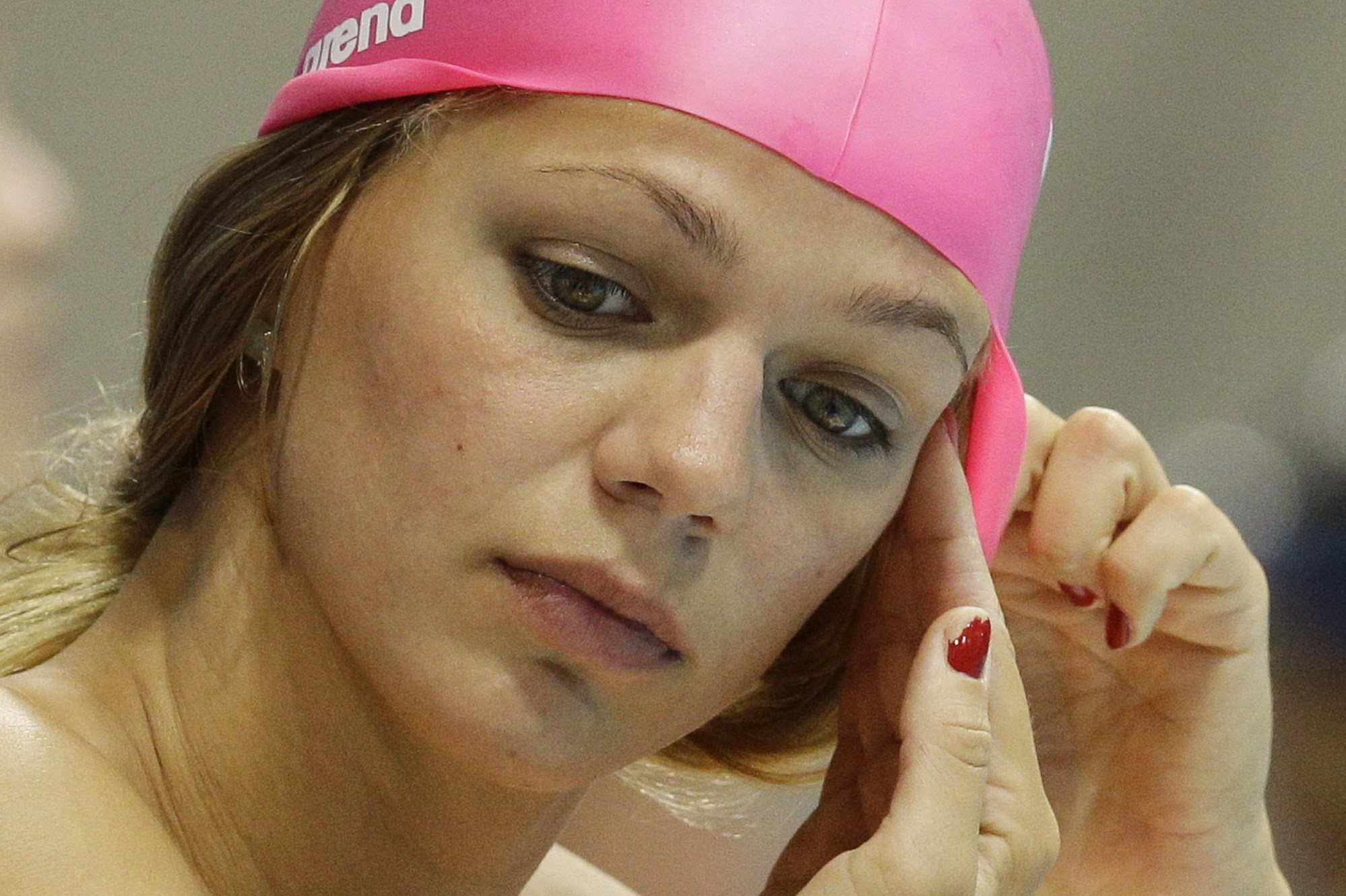 FILE - In this July 27, 2012, file photo, Russia's Yulia Efimova prepares for a practice session at the Aquatics Centre in the Olympic Park ahead of the 2012 Summer Olympics, in London. Swimming governing body FINA has ruled seven Russian swimmers ineligi