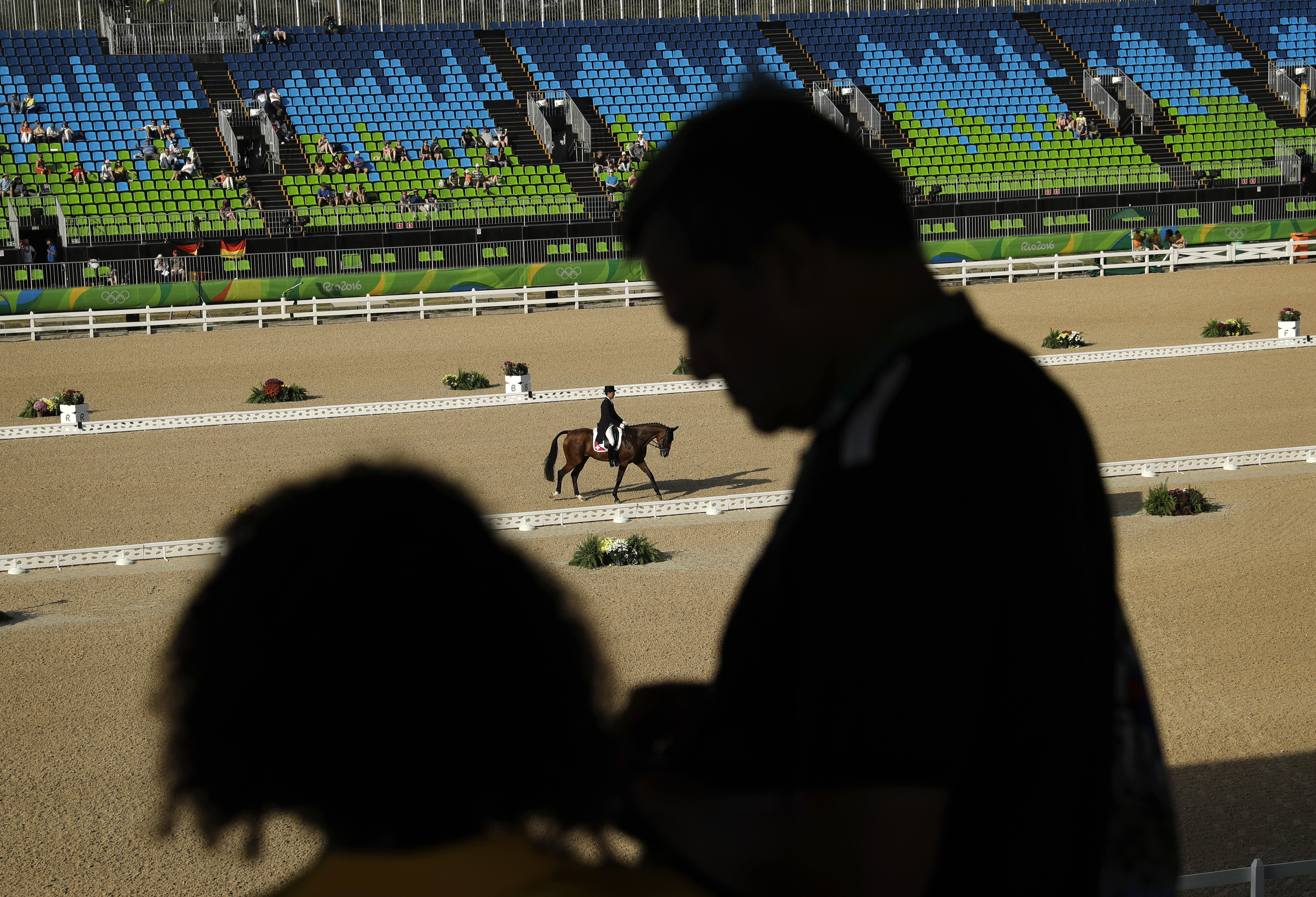 Felix Vogg, of Switzerland, rides Onfire in the equestrian eventing dressage competition at the 2016 Summer Olympics in Rio de Janeiro, Brazil, Saturday, Aug. 6, 2016. (AP Photo/John Locher)