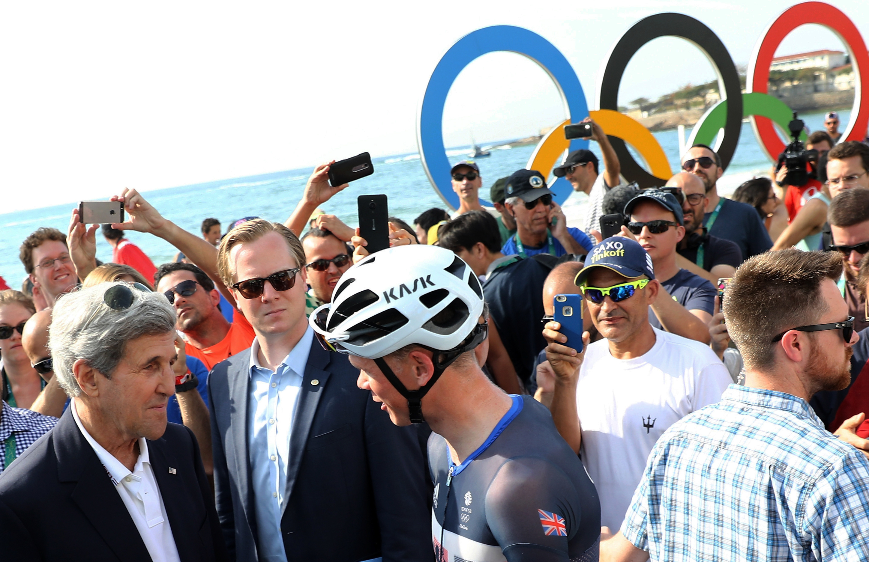 U.S. Secretary of State John Kerry, left, talks with Christopher Froome, of Britain, before the men's cycling road race final at the 2016 Summer Olympics in Rio de Janeiro, Brazil, Saturday, Aug. 6, 2016. (Bryn Lennon/Pool Photo via AP)
