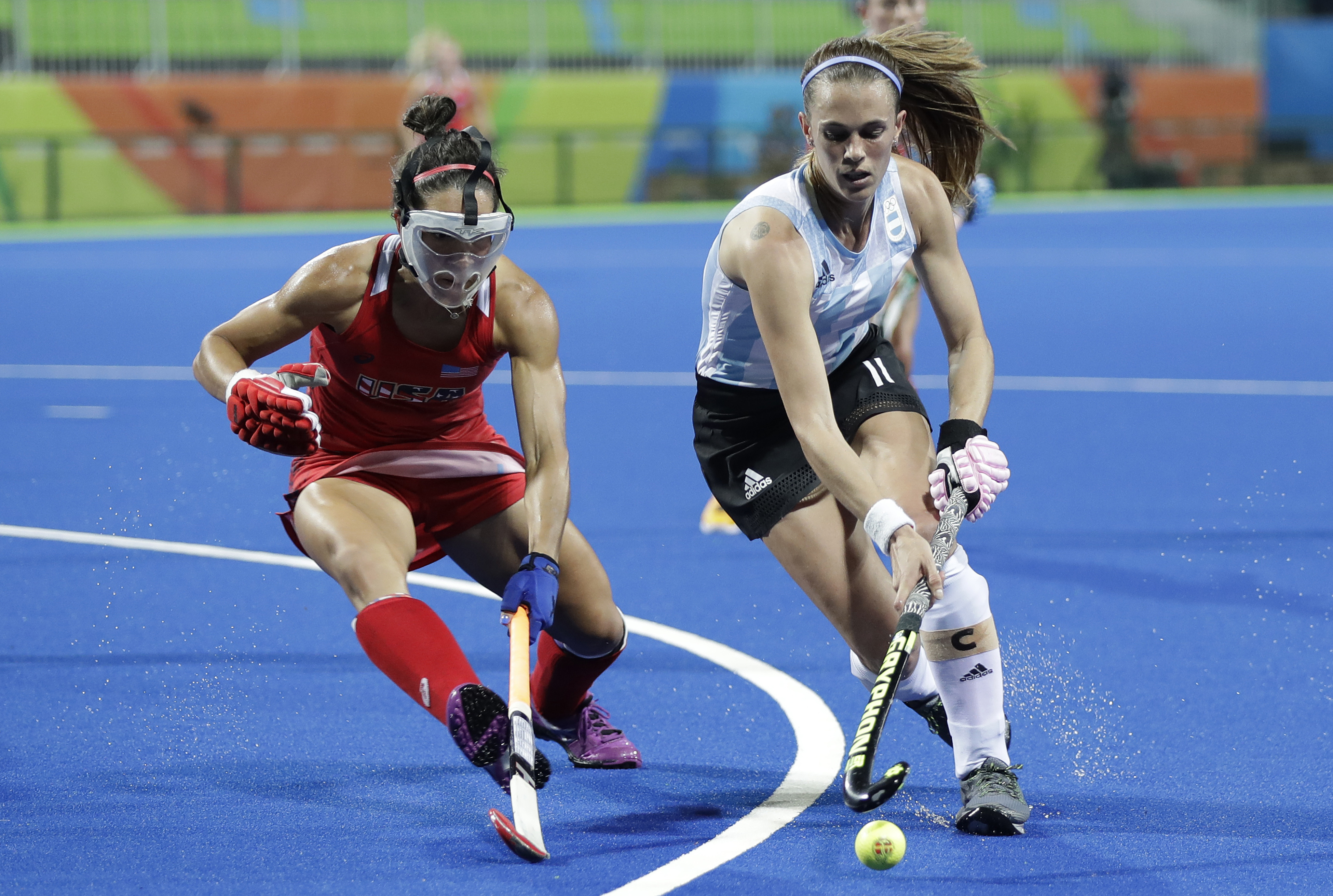 Argentina's Carla Rebecchi, right, fight for the ball with United States' Melissa Gonzalez, left, during a women's field hockey match at 2016 Summer Olympics in Rio de Janeiro, Brazil, Saturday, Aug. 6, 2016. (AP Photo/Hussein Malla)