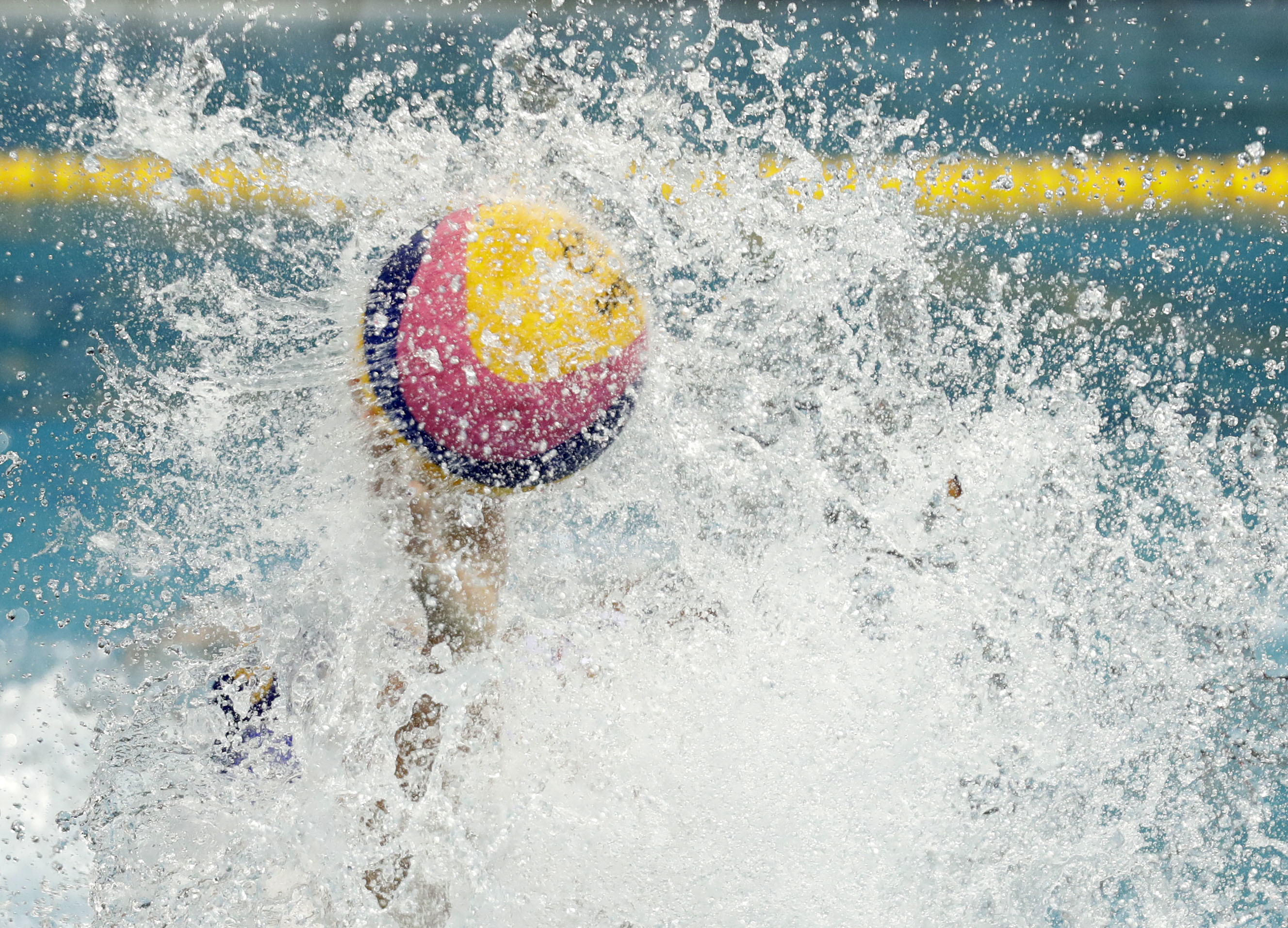 Montenegro's Aleksandar Ivovic shoots against France during men's water polo preliminary round match at the 2016 Summer Olympics in Rio de Janeiro, Brazil, Saturday, Aug. 6, 2016. (AP Photo/Sergei Grits)