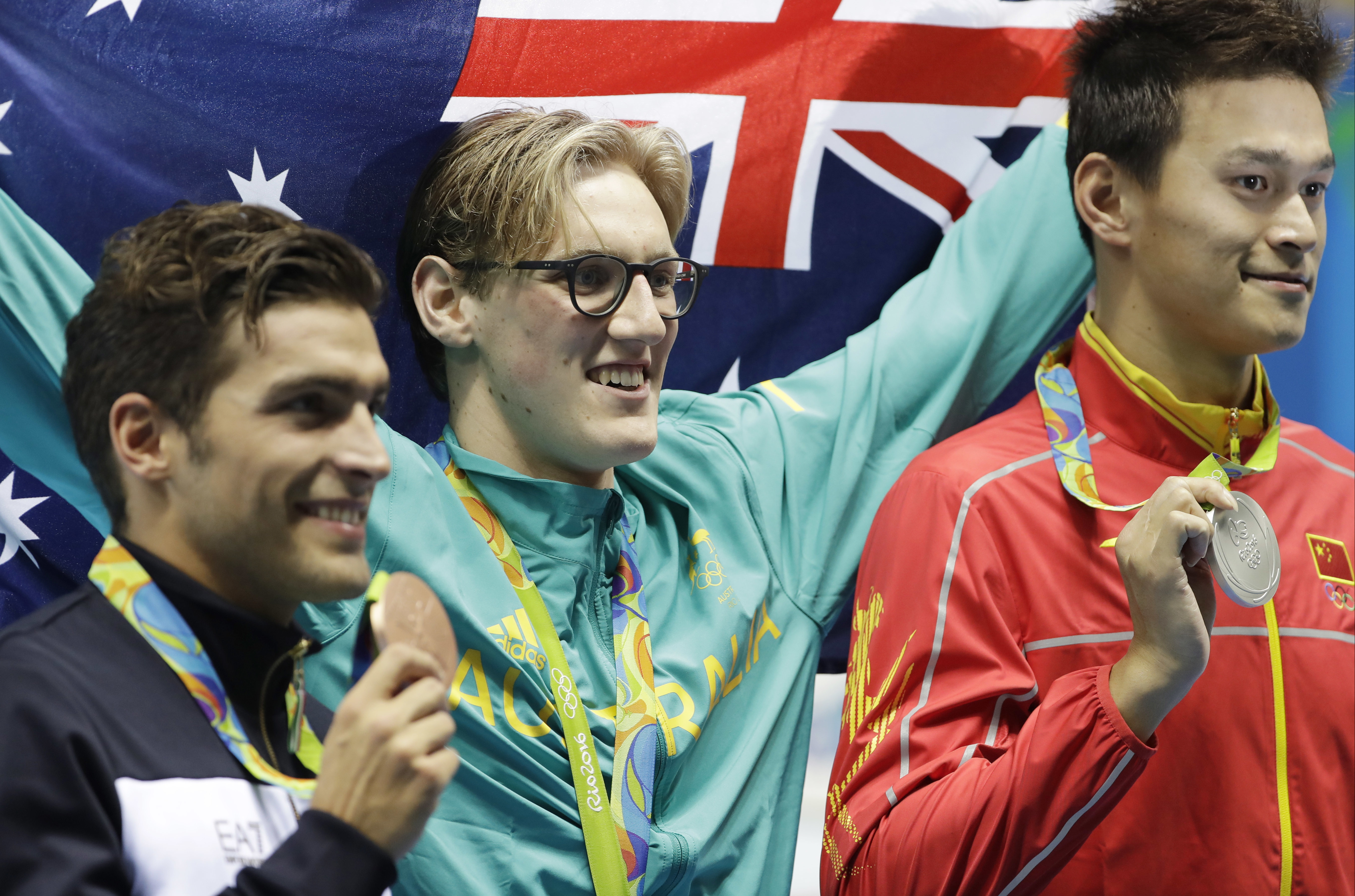 Winner Australia's Mack Horton, center, second placed Italy's Gabriele Detti, left, and third placed China's Sun Yang hold their medals after the men's 400-meter freestyle during the swimming competitions at the 2016 Summer Olympics, Saturday, Aug. 6, 201