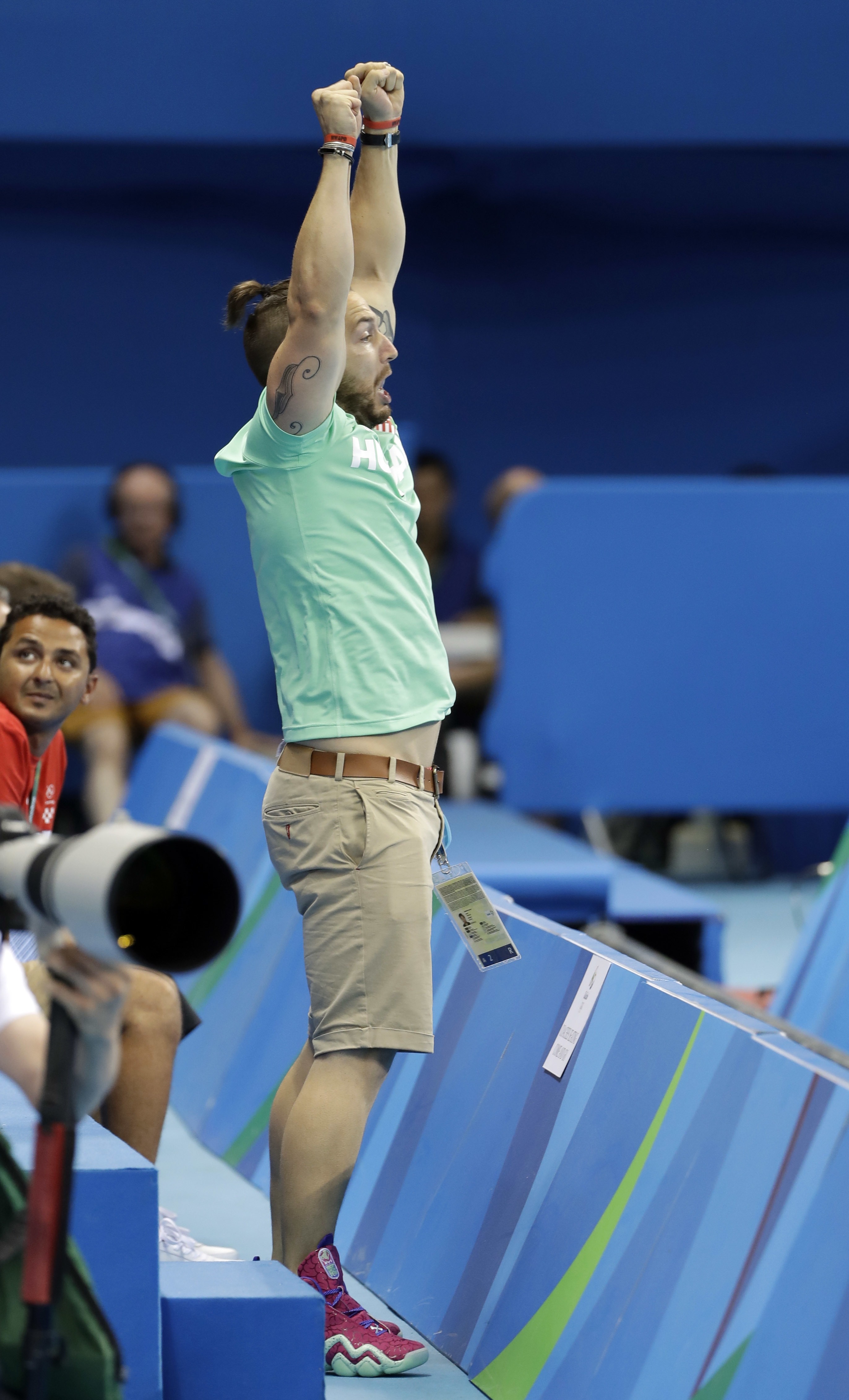 Shane Tusup, the husband of Hungary's Katinka Hosszu, celebrates after she wins the gold medal in the women's 400-meter individual medley during the swimming competitions at the 2016 Summer Olympics, Saturday, Aug. 6, 2016, in Rio de Janeiro, Brazil. (AP